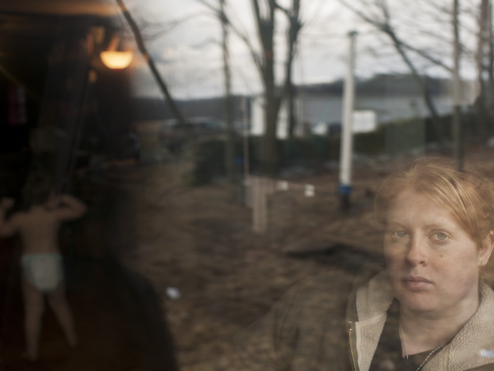 Tamara Horn seen with her son in their trailer. Dimock, Susquehanna County, 2012.  ©   Nina Berman/MSDP 2012