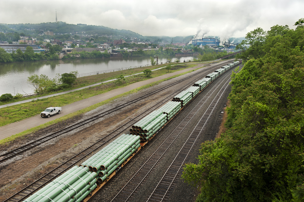 """In Homestead, PA, a freight train carries underground transport pipe for thewestern PA natural gas drillers. ©       Normal   0           false   false   false     EN-US   X-NONE   X-NONE                                                                                                                                                                                                                                                                                                                                                                           /* Style Definitions */  table.MsoNormalTable {mso-style-name:""""Table Normal""""; mso-tstyle-rowband-size:0; mso-tstyle-colband-size:0; mso-style-noshow:yes; mso-style-priority:99; mso-style-parent:""""""""; mso-padding-alt:0in 5.4pt 0in 5.4pt; mso-para-margin-top:0in; mso-para-margin-right:0in; mso-para-margin-bottom:10.0pt; mso-para-margin-left:0in; line-height:115%; mso-pagination:widow-orphan; font-size:11.0pt; font-family:""""Calibri"""",""""sans-serif""""; mso-ascii-font-family:Calibri; mso-ascii-theme-font:minor-latin; mso-hansi-font-family:Calibri; mso-hansi-theme-font:minor-latin;}     Scott Goldsmith/MSDP 2012"""