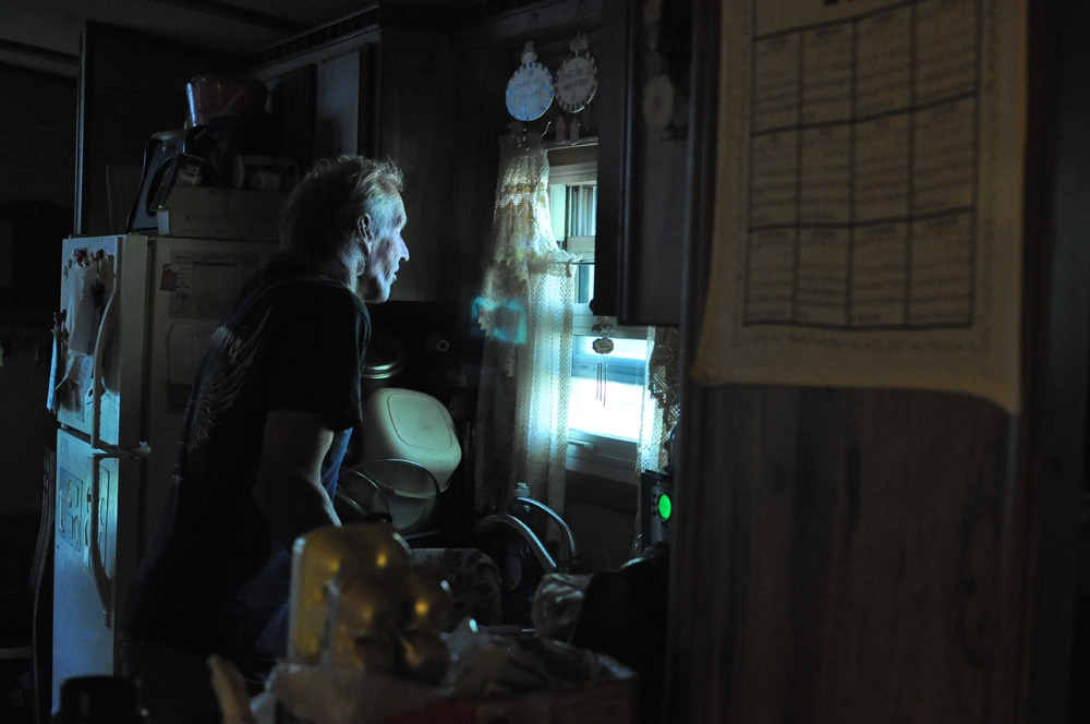 """Fred McIntyre at the window of his home in Connoquenessing Township, PA. May, 2012.                           Though the day was warm and sunny, Fred and Janet were forced to move inside due to the acrid quality of the air. ©       Normal   0           false   false   false     EN-US   X-NONE   X-NONE                                                                                                                                                                                                                                                                                                                                                                           /* Style Definitions */  table.MsoNormalTable {mso-style-name:""""Table Normal""""; mso-tstyle-rowband-size:0; mso-tstyle-colband-size:0; mso-style-noshow:yes; mso-style-priority:99; mso-style-parent:""""""""; mso-padding-alt:0in 5.4pt 0in 5.4pt; mso-para-margin-top:0in; mso-para-margin-right:0in; mso-para-margin-bottom:10.0pt; mso-para-margin-left:0in; line-height:115%; mso-pagination:widow-orphan; font-size:11.0pt; font-family:""""Calibri"""",""""sans-serif""""; mso-ascii-font-family:Calibri; mso-ascii-theme-font:minor-latin; mso-hansi-font-family:Calibri; mso-hansi-theme-font:minor-latin;}     Brian Cohen/MSDP 2012       Normal   0           false   false   false     EN-US   X-NONE   X-NONE                                                                                                                                                                                                                                                                                                                                                                           /* Style Definitions */  table.MsoNormalTable {mso-style-name:""""Table Normal""""; mso-tstyle-rowband-size:0; mso-tstyle-colband-size:0; mso-style-noshow:yes; mso-style-priority:99; mso-style-parent:""""""""; mso-padding-alt:0in 5.4pt 0in 5.4pt; mso-para-margin-top:0in; mso-para-margin-right:0in; mso-par"""