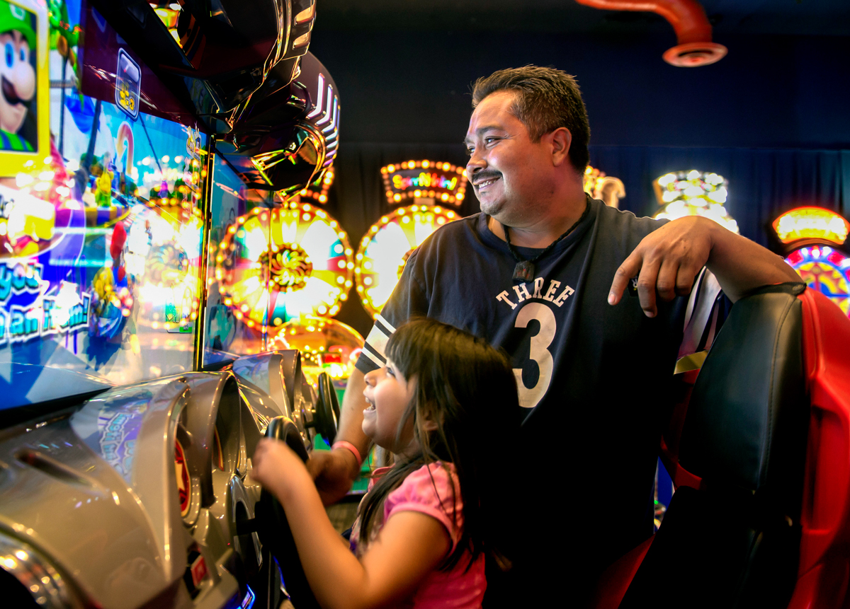 Brianna and her dad enjoy the games at Dave & Buster's.  © Nate Guidry/TDW 2017