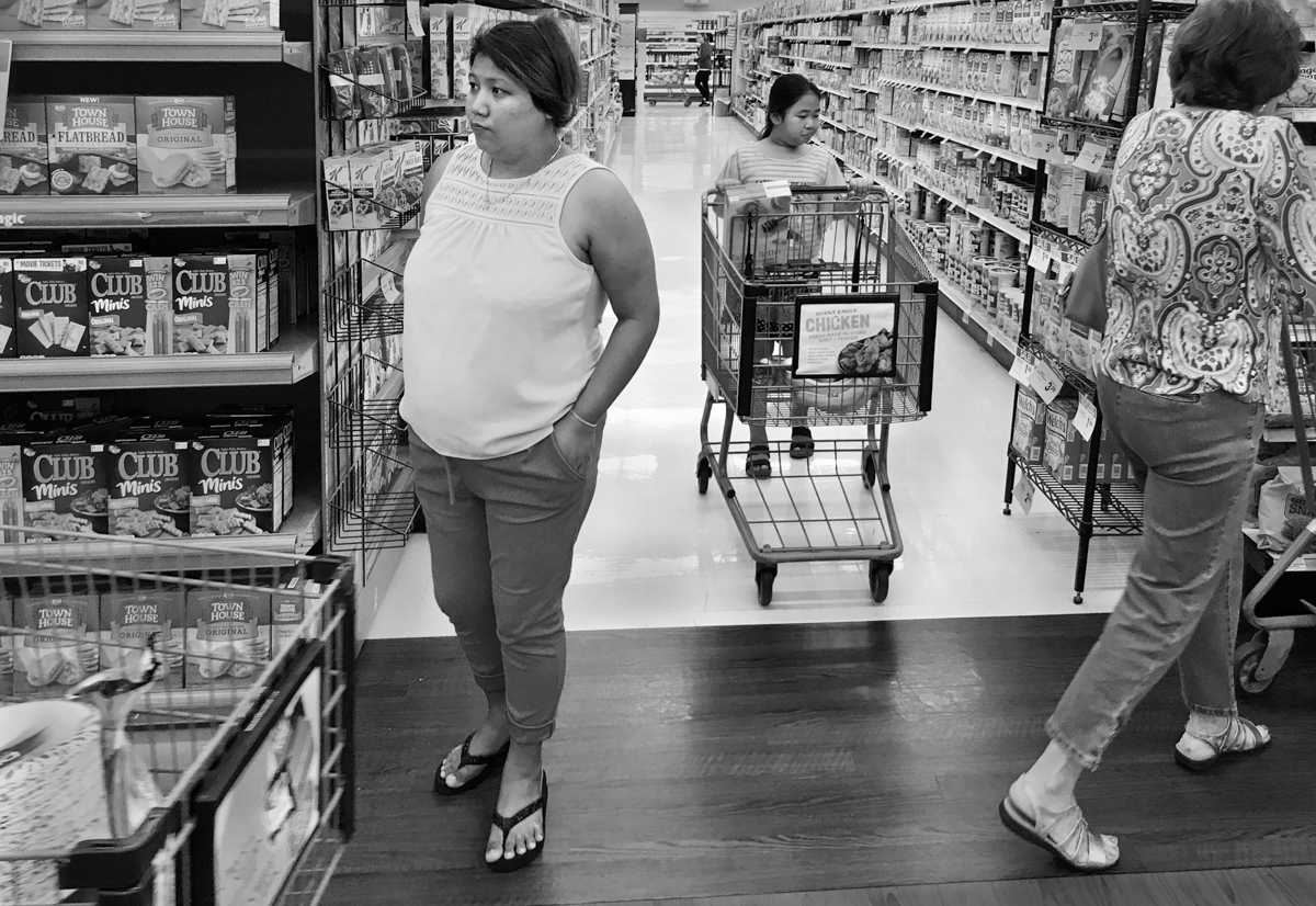 After living in the Brentwood neighborhood of Pittsburgh for three months, Kheena Gurung made her first visit to a large grocery store. She took her niece, Salina Rai, age nine, to help translate and guide her through the store. Kheena seemed overwhelmed and confused at times.  © Scott Goldsmith/TDW 2017