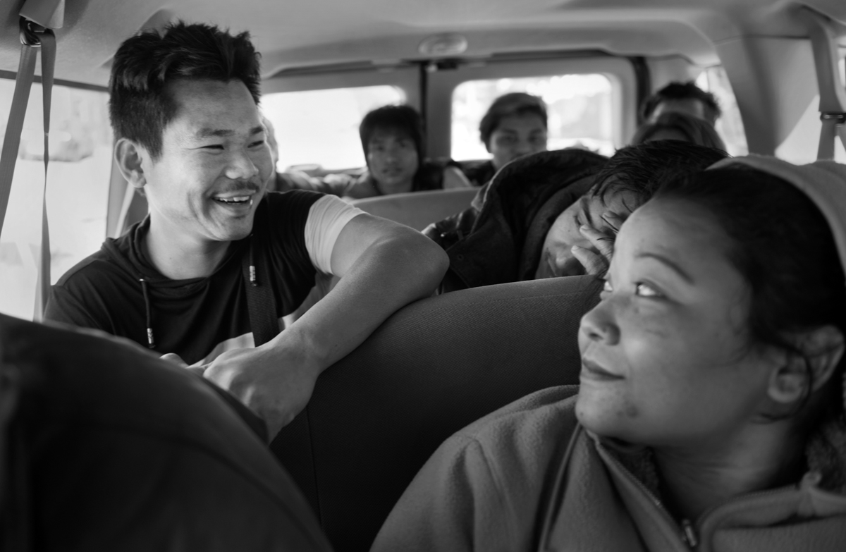 Som is riding a van that will take him to work with about 15 other immigrants and refugees from the Pittsburgh area. All of these people are driven to Spears, PA where they work from 4 p.m. to 2 a.m. packing frozen meat for wholesale.  © Scott Goldsmith/TDW 2017