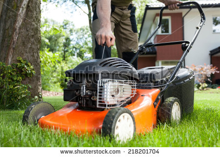 stock-photo-turning-on-the-lawn-mower-by-gardener-218201704.jpg