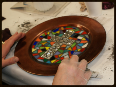 A cross-themed mosaic plate created from Peace by Piece.