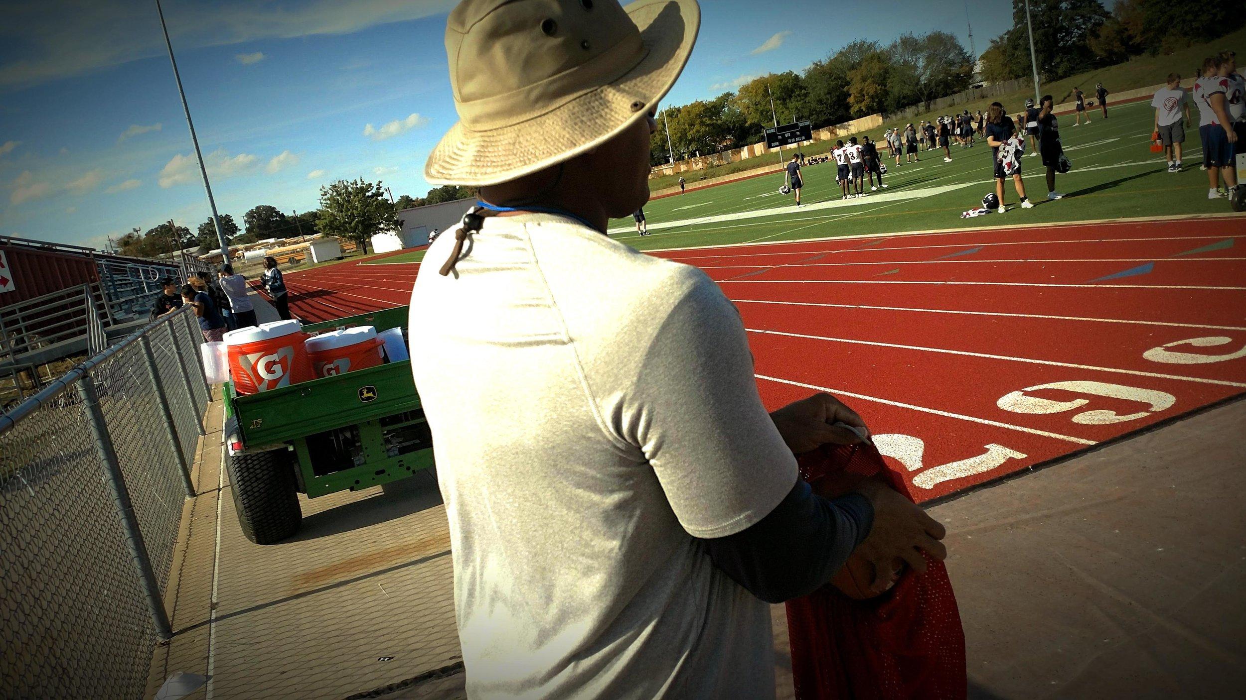 Photo of Cobbs coaching Ryan's football team.  Photo by Jordan Brown.
