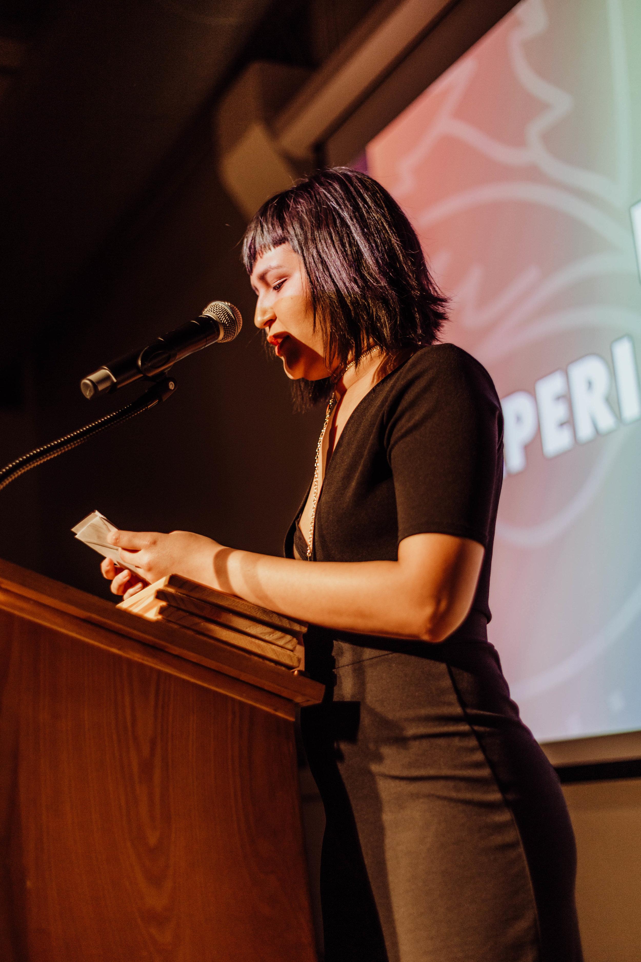 Isabel Deniz presenting awards.