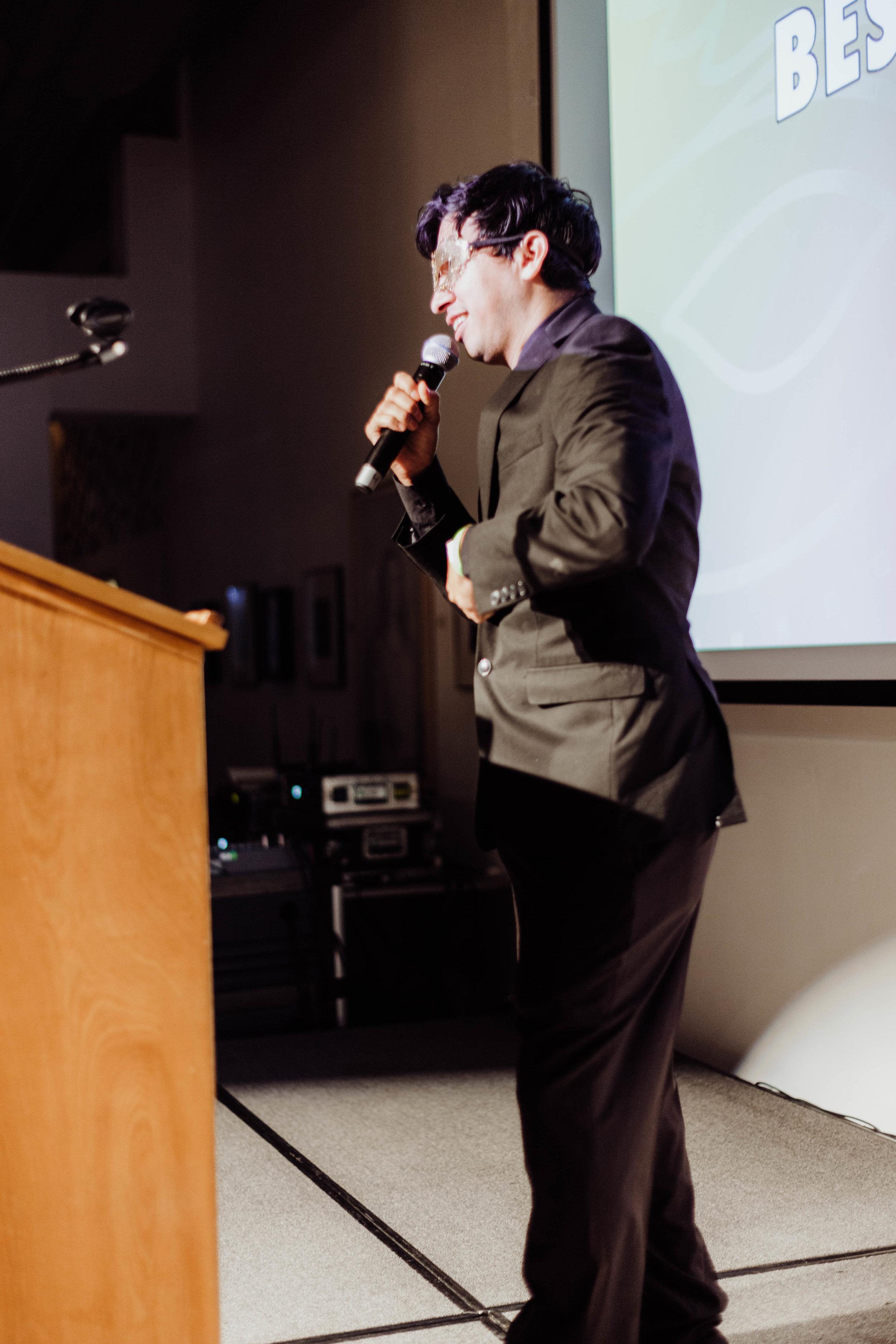 Mateo Granados presenting awards.