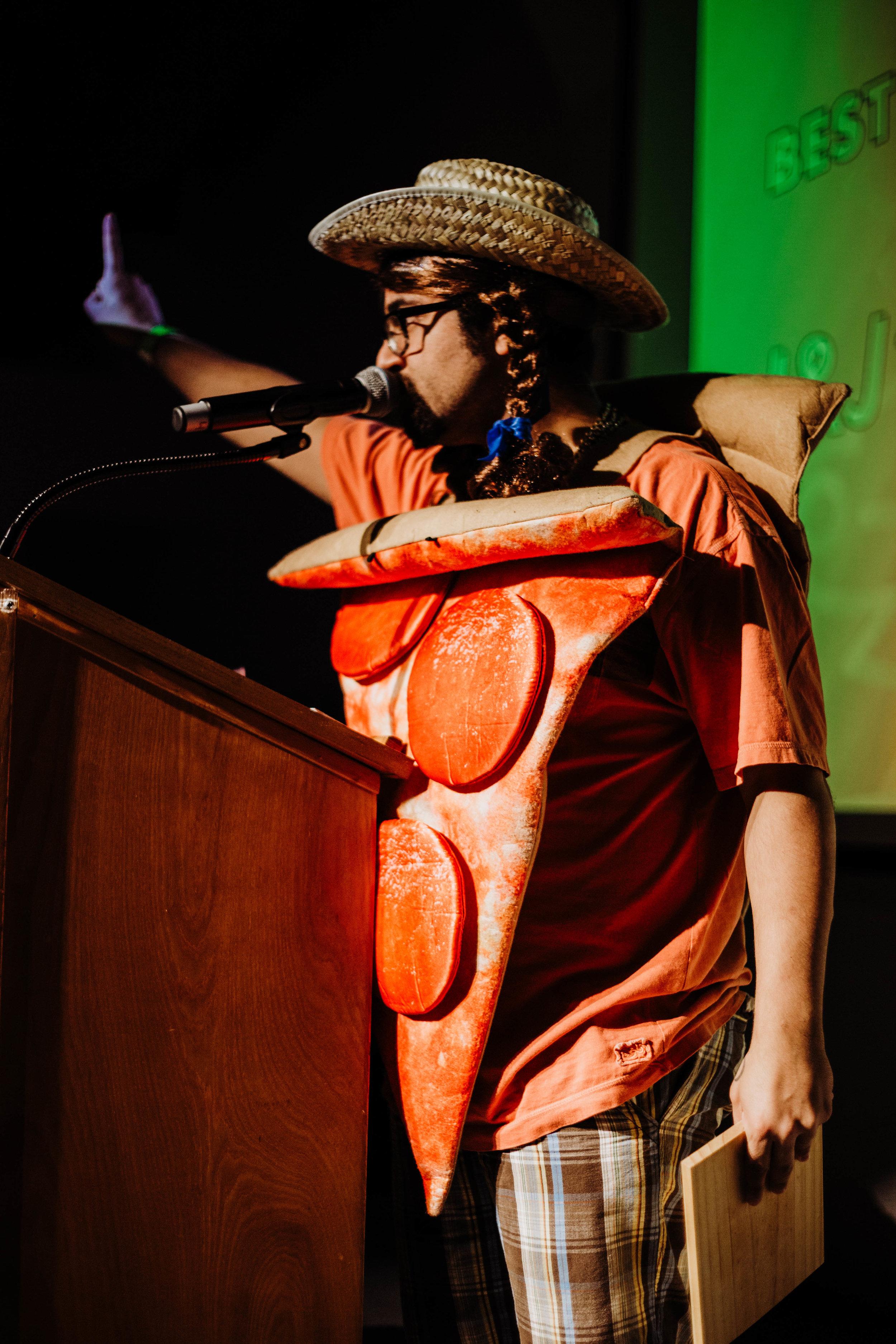 Gerardo Reyes - Character. - accepting his award.