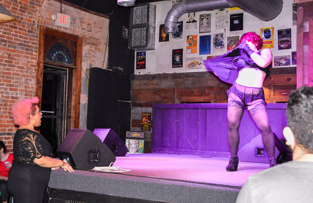 Burlesque dancer Mistress Red Velvet performing.