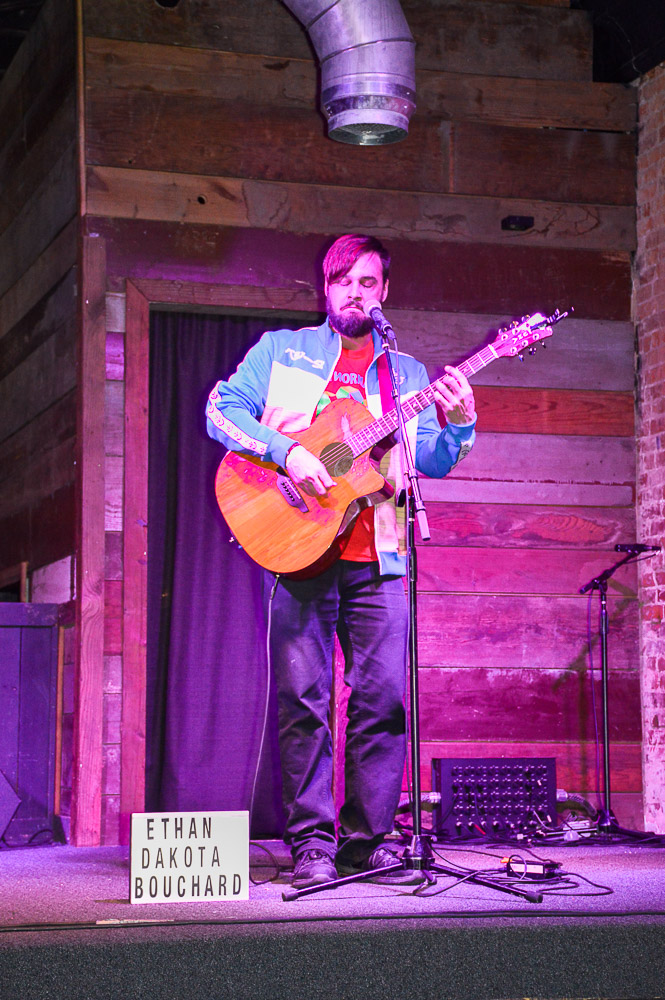Ethan Dakota Bouchard playing live, acoustic music.