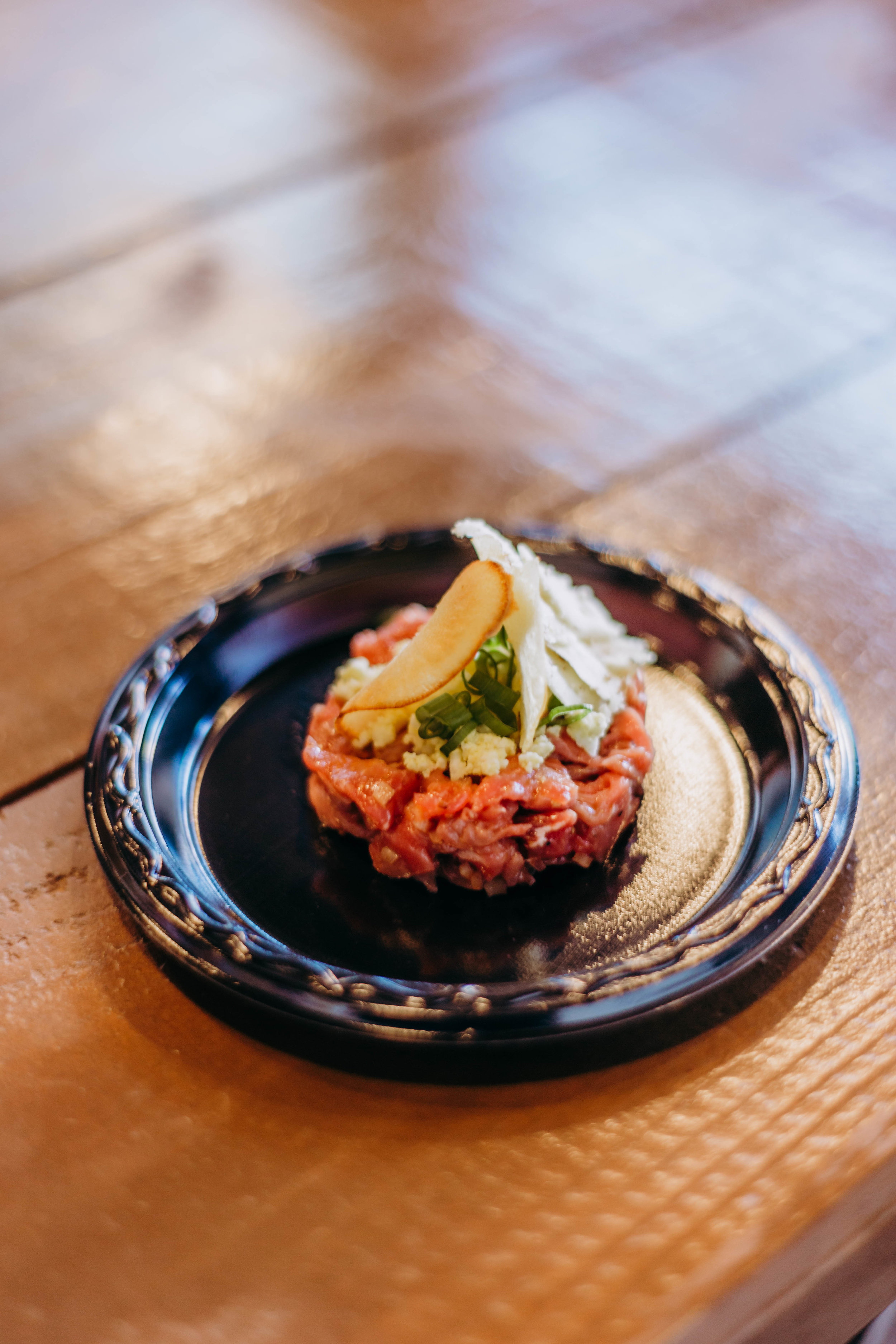 The first course - Beef Tartar with Herbs and Boiled Egg paired with Red Dragon Cheese. Photo by Jennifer Meza.