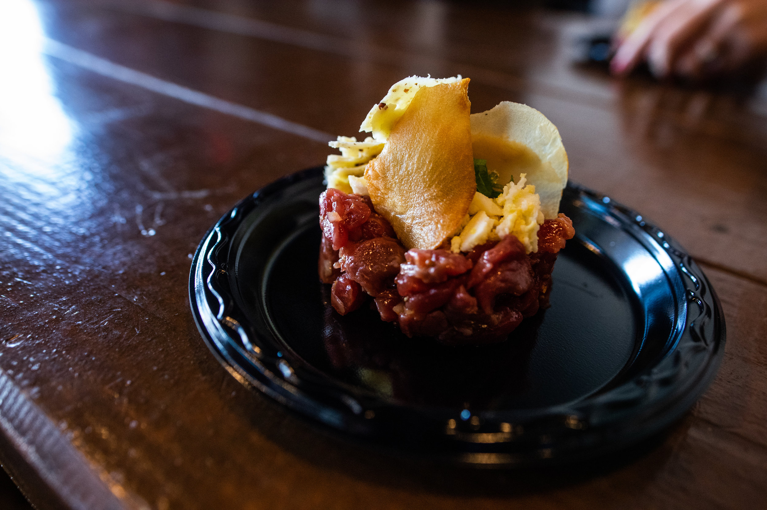 The first course - Beef Tartar with Herbs and Boiled Egg paired with Red Dragon Cheese. - Photo by Garrett Smith