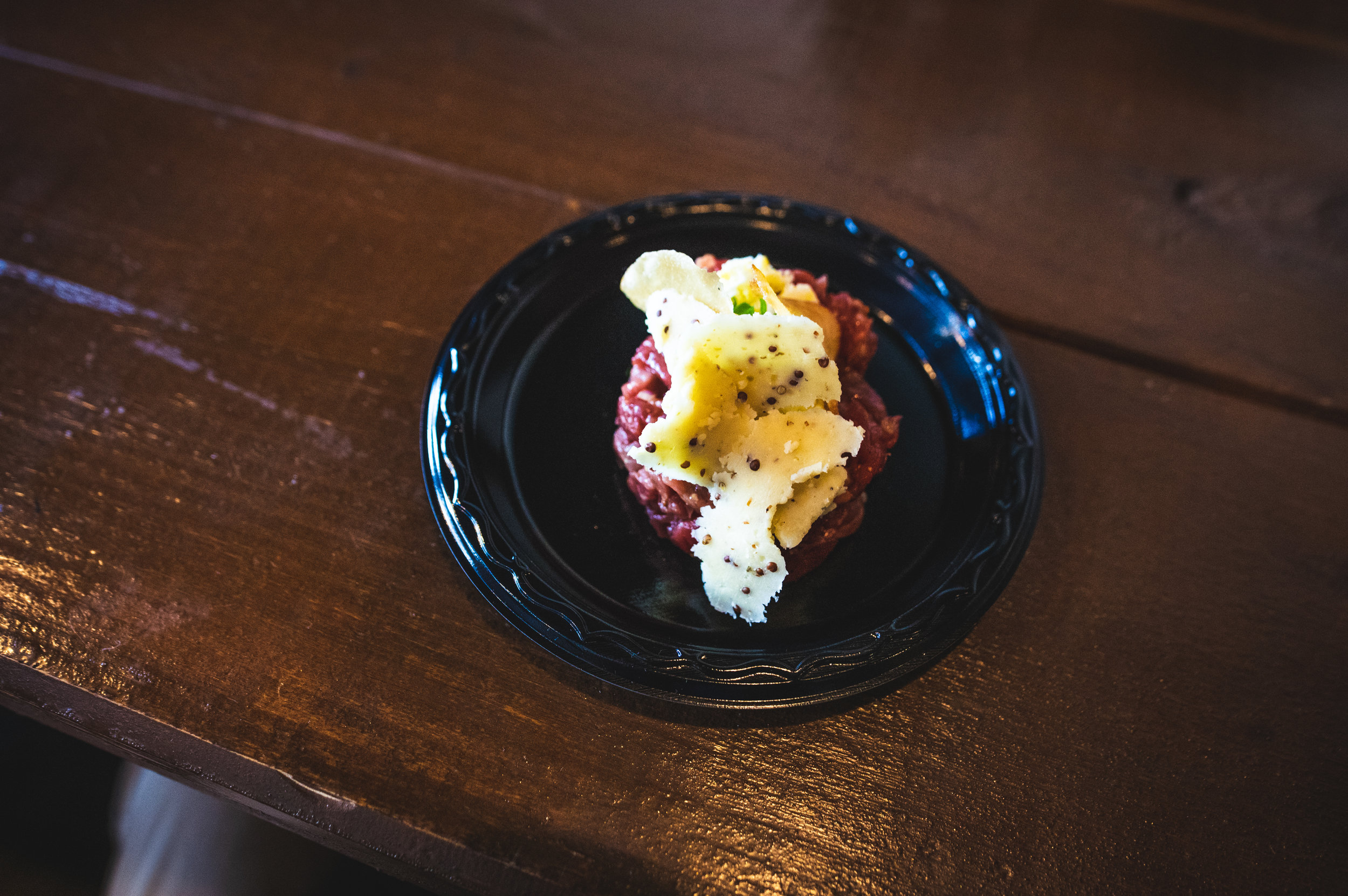 The first course - Beef Tartar with Herbs and Boiled Egg paired with Red Dragon Cheese. Photo by Garrett Smith.