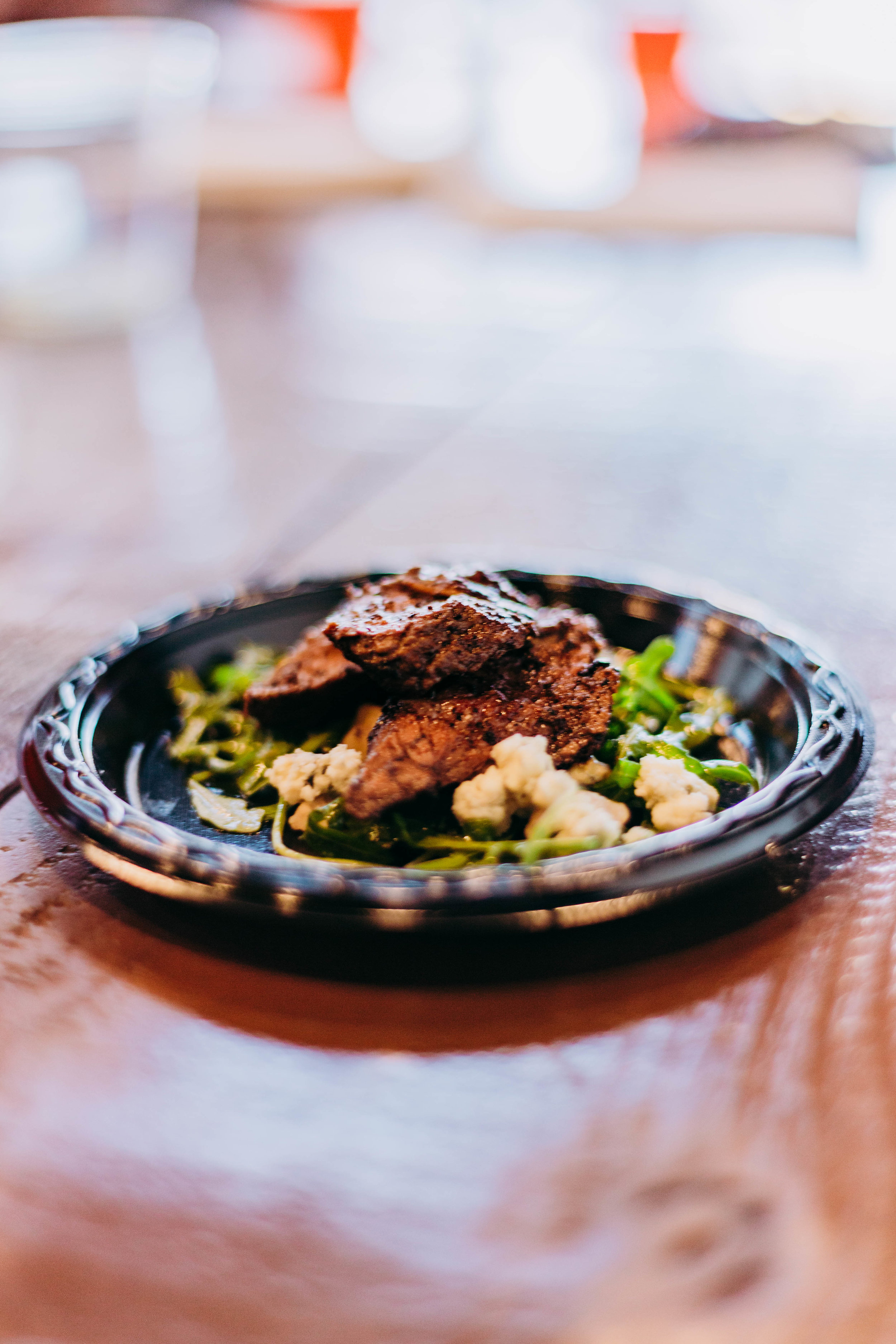 The second course: Steak Salad with Walnuts, Citrus Dressing, and Foir D'Avancio Cheese. Photo by Jennifer Meza.