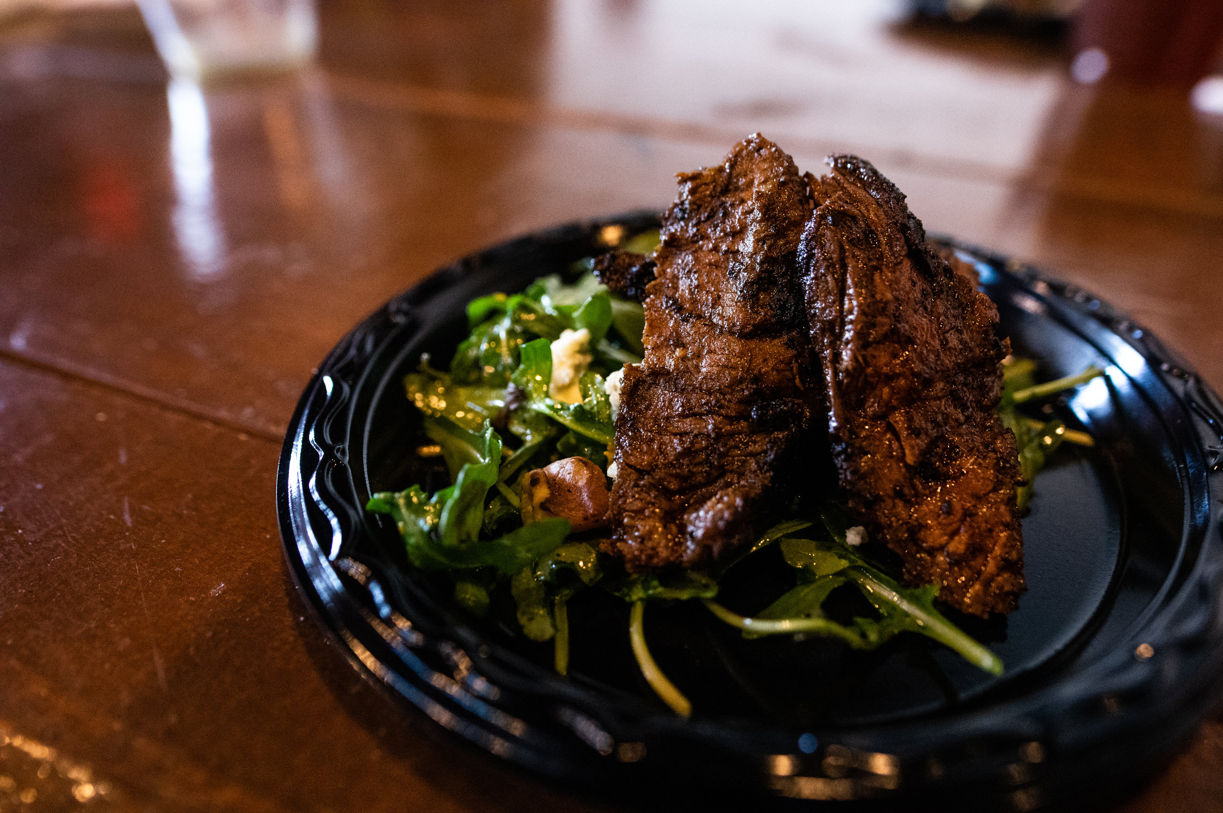 The second course: Steak Salad with Walnuts, Citrus Dressing, and Foir D'Avancio Cheese. Photo by Garrett Smith.