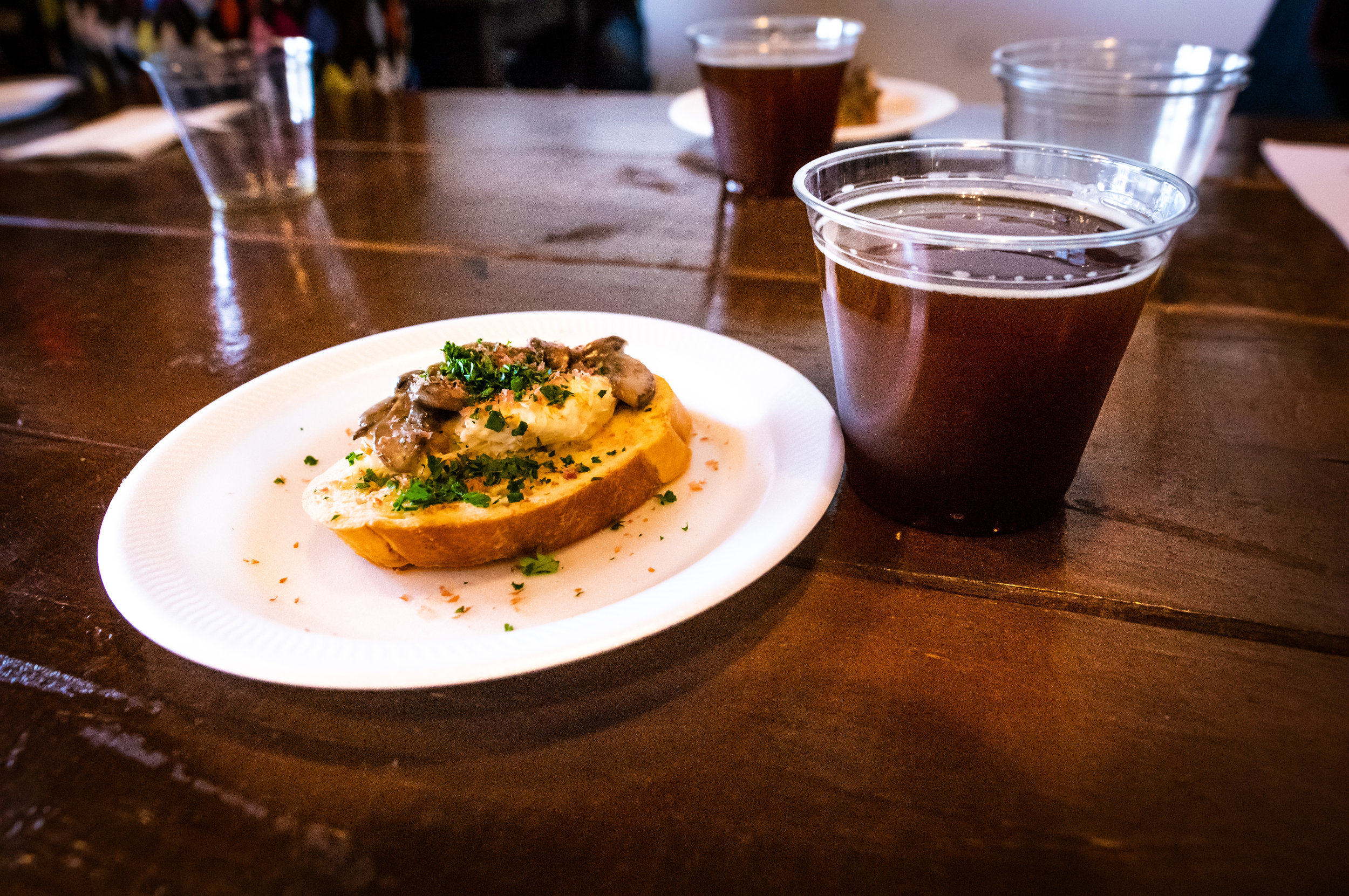The third course, consisting of Mushroom and Beef Jerky Crostini, paired with Armadillo's Winterstellar and Ten:One's Delice De Bourgone. Photo by Garrett Smith.