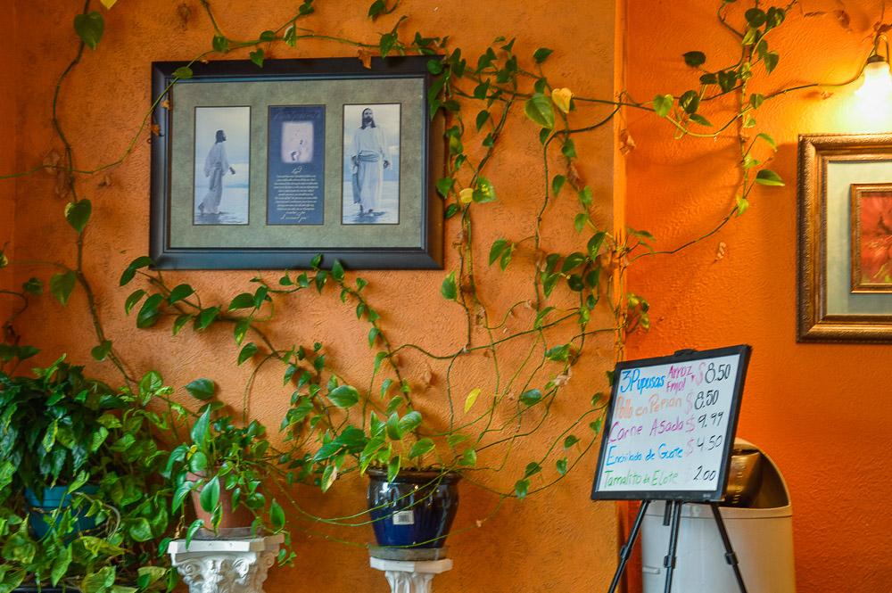 Guatelinda decor - Spanish menu and Catholic imagery on the walls.
