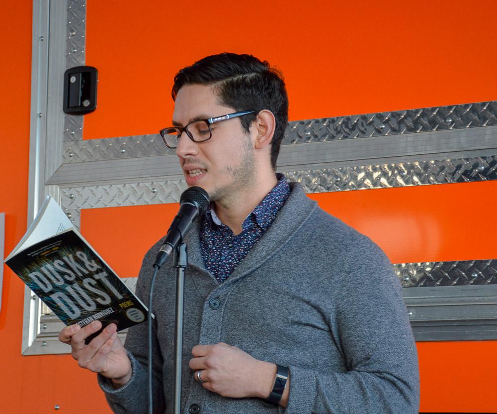 Esteban Rodríguez reading for the event.