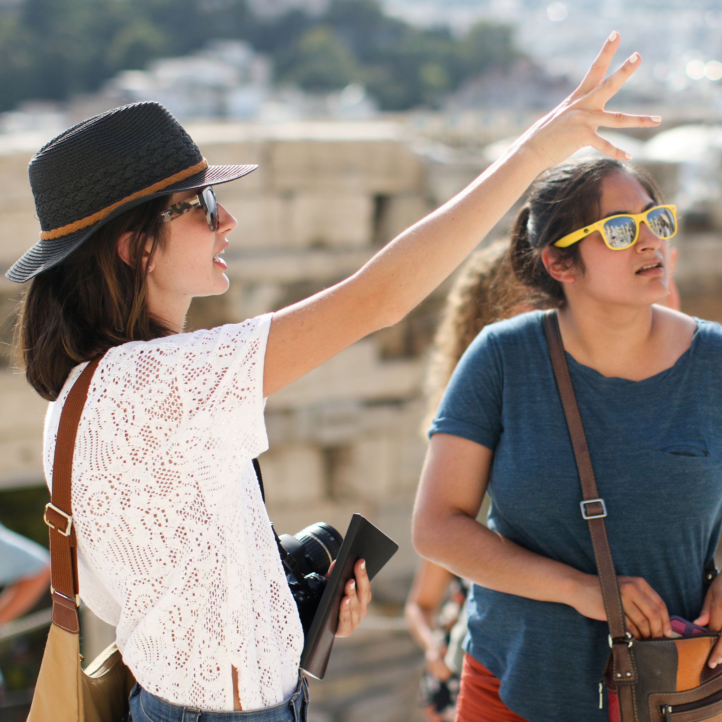 A HellaTravels gives a private tour of the acropolis in Athens to one of our solo female travelers on a Greece tour.