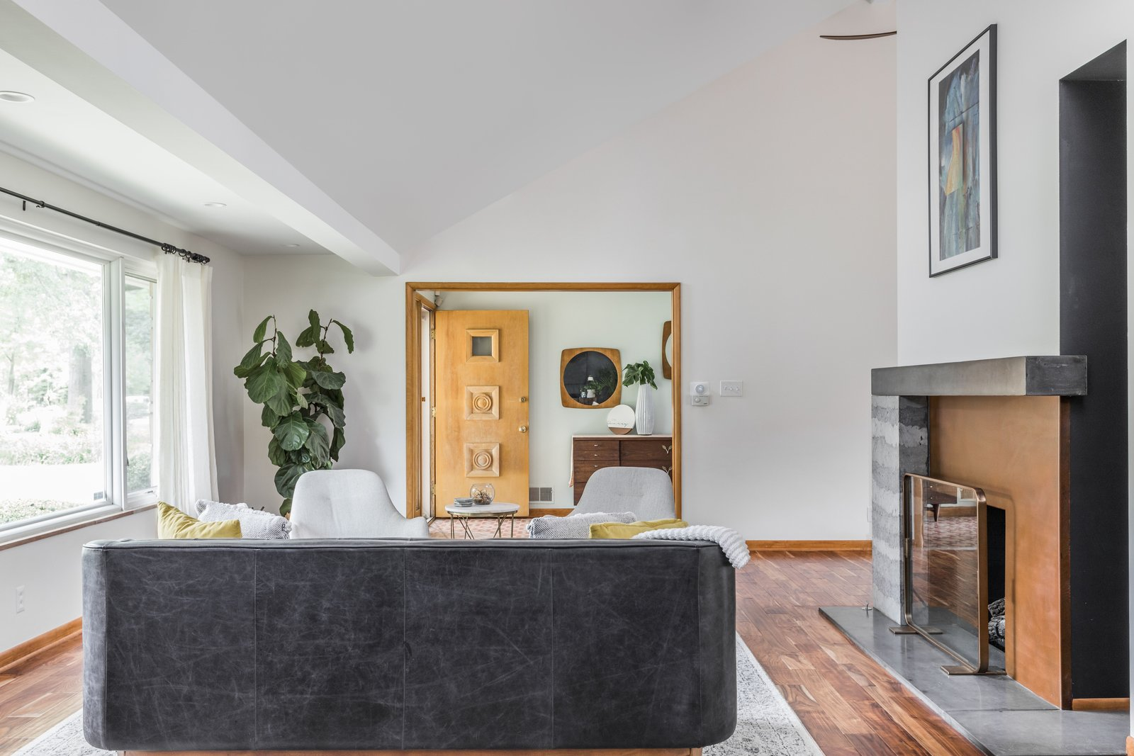 the-new-eight-foot-tall-chimney-though-the-cutout-was-never-a-part-of-their-original-plan-they-now-love-this-unique-feature-as-it-brings-ample-light-into-the-dining-room.jpg
