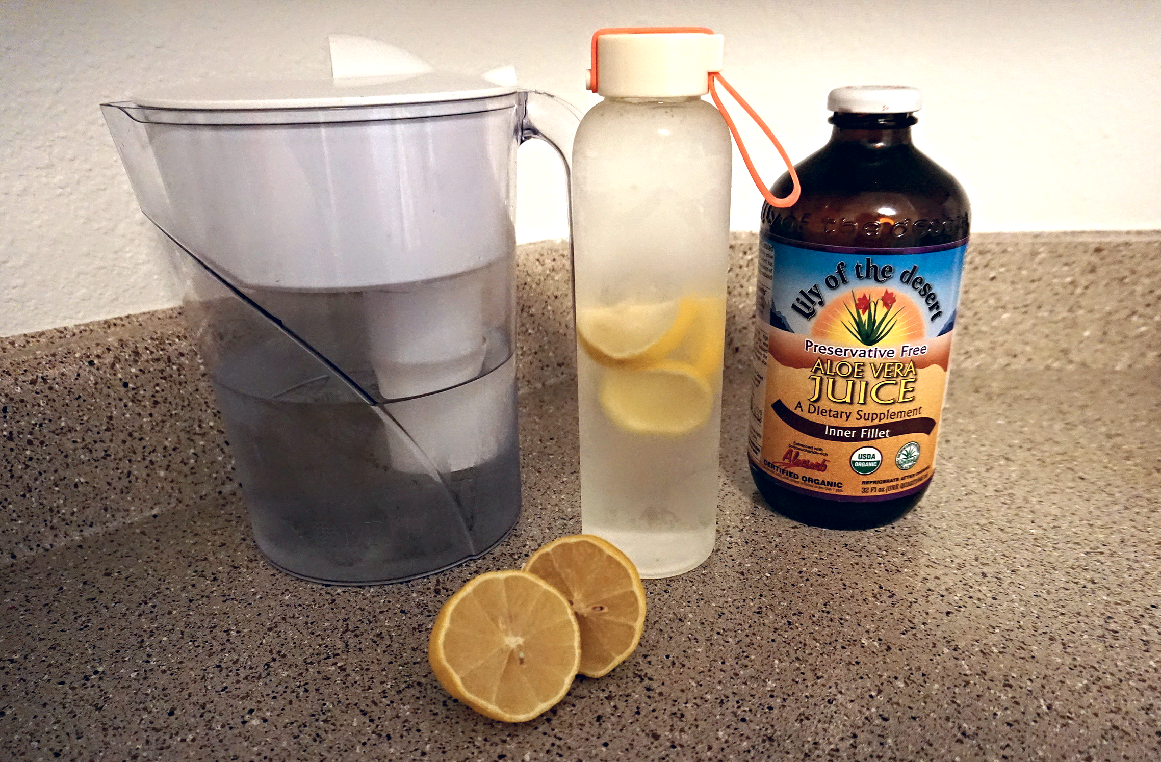 My personal pre-workout drink: Water, aloe vera juice, and lemon water.