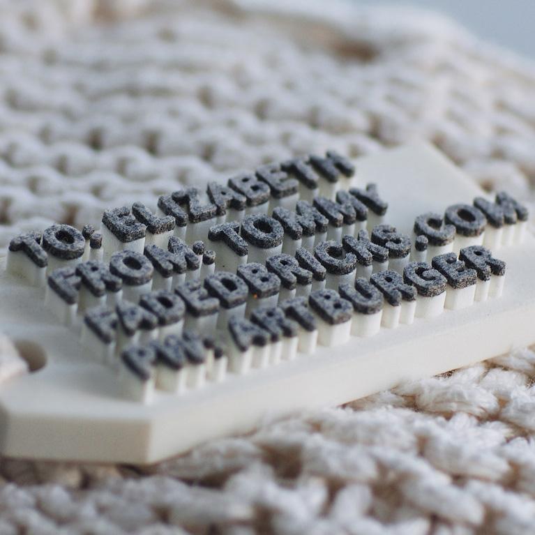 CLIENT: Tommy Cinquegrano  PROJECT: 3-D tags PROCESS: Laser cut felt letters glued to 3-D printed block PHOTO CREDIT: Tommy Cinquegrano