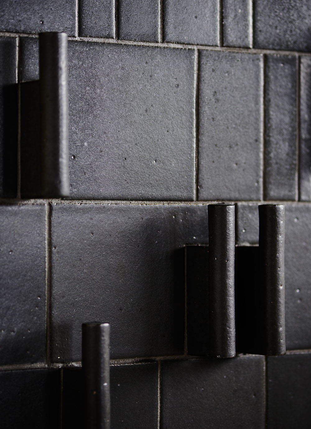 Various sizes in Charcoal Glaze with custom tile surround
