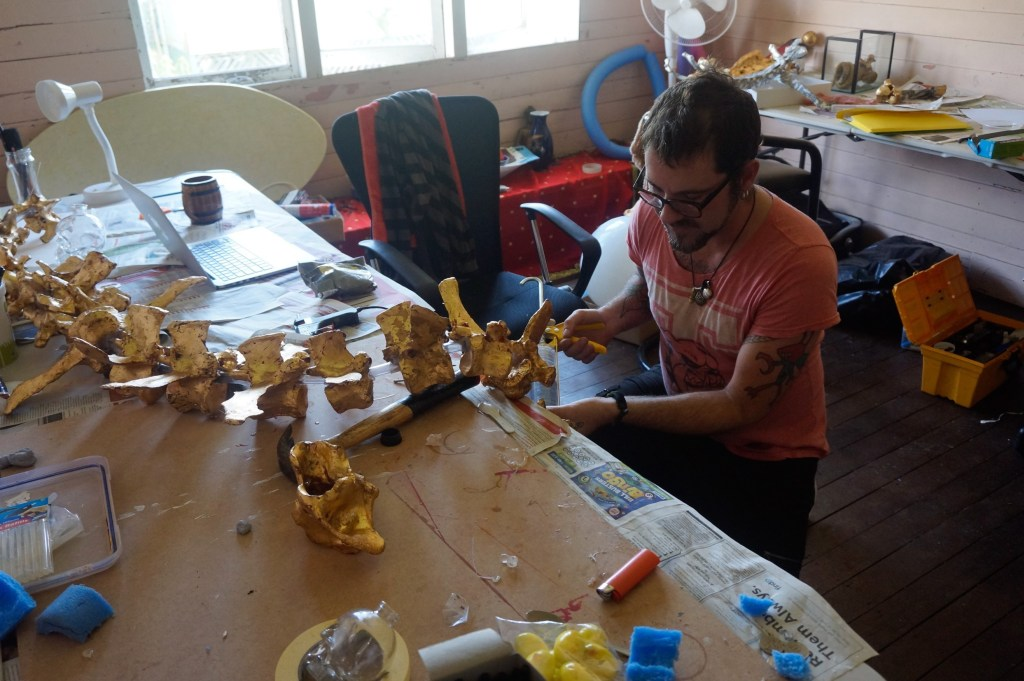 On Process – EPICORMIA - Epicormia Collective artist Jeremy Hawkes at work guilding bones in his artist studio in Lismore September 2016