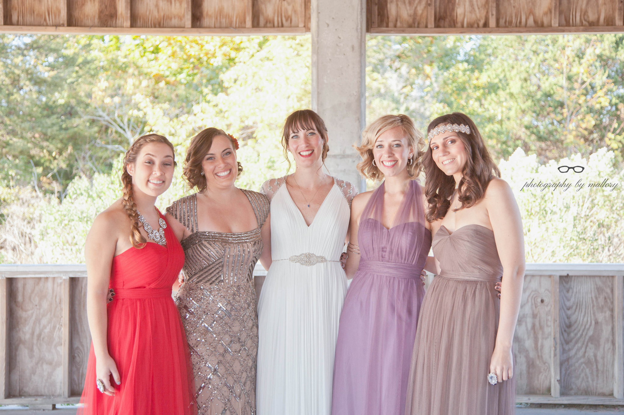Fun fact: The three bridesmaid dresses (MOH is in sparkles) are all the same dress. The color and the tying of the sashes made them appear different. These are BHDLN dresses.