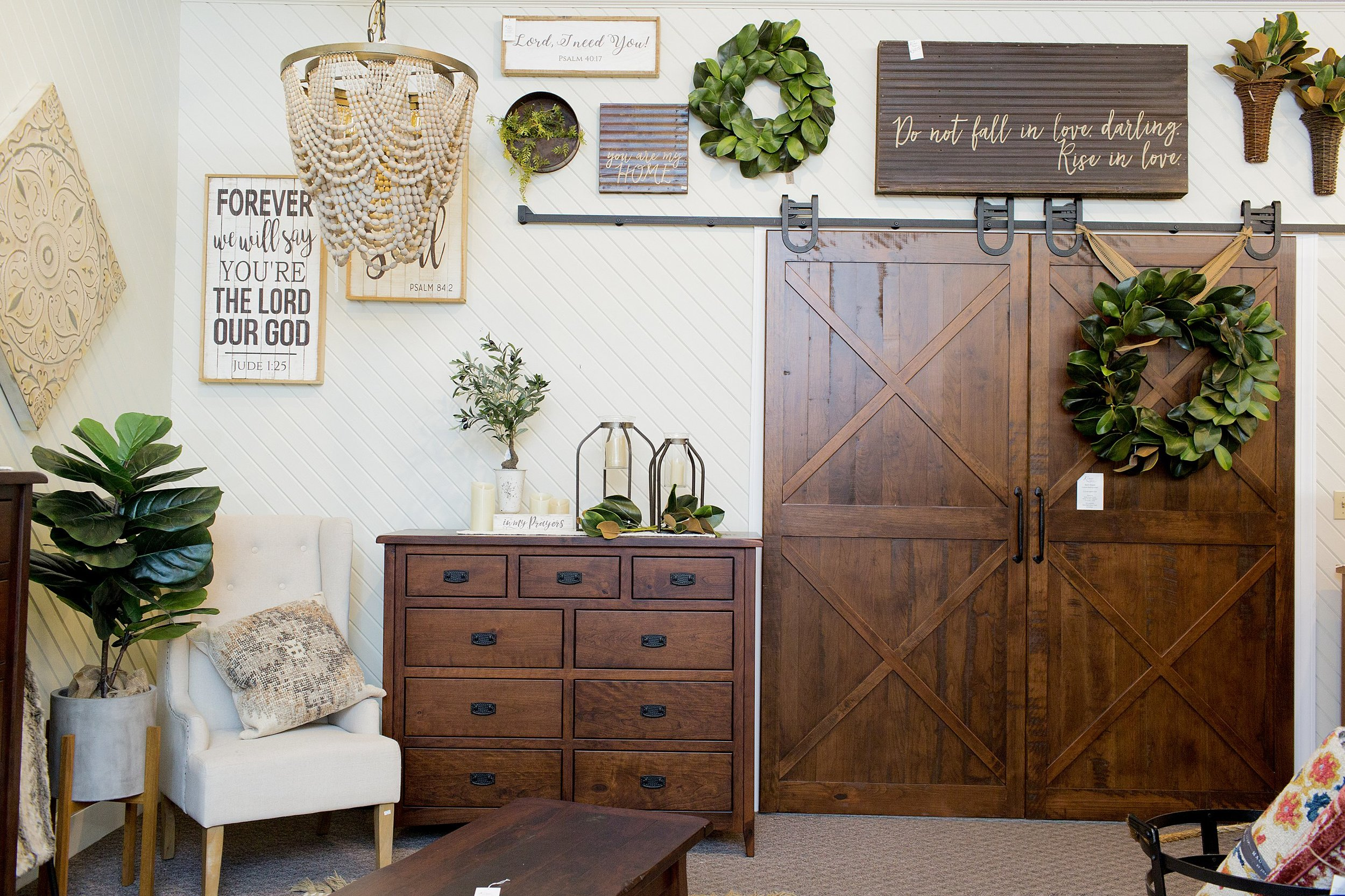 Everyone's new favorite wall and favorite room in the upstairs sections. This room features our Rough Sawn Bedroom Set. Click the button below to visit facebook for the complete set showcasing all the different pieces.
