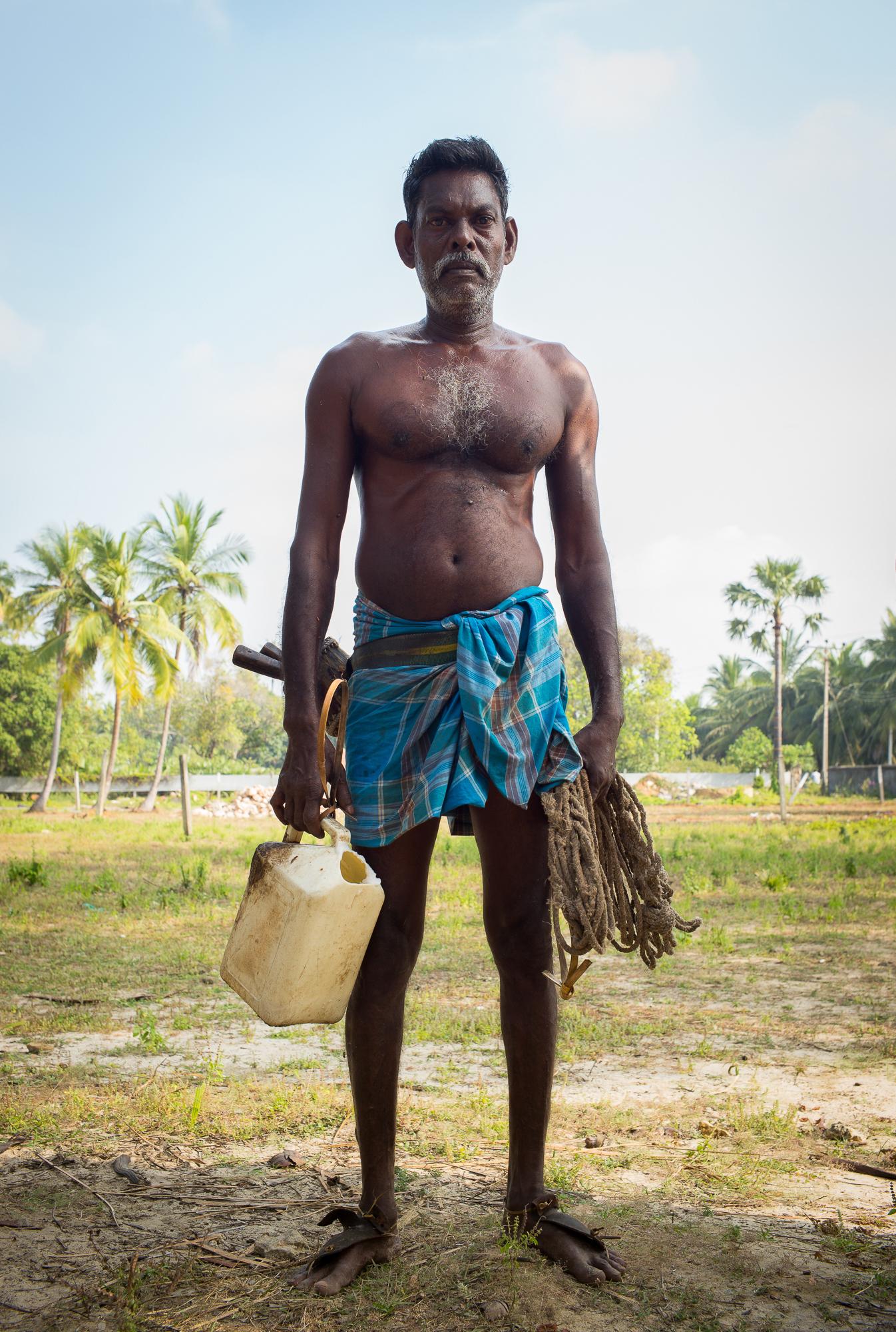 A toddy tapper outside the village of Navaly near Jaffna, northern Sri Lanka.