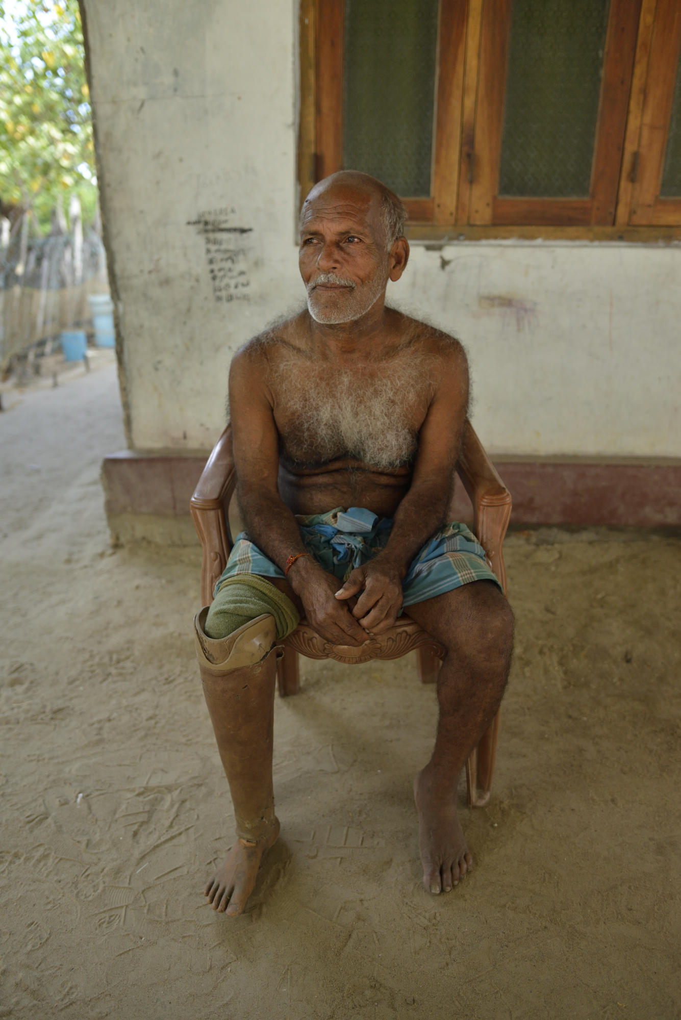 Kanathathi Kidnar, 70, a former tapper, lost his leg to a land mine near his village in 2001.