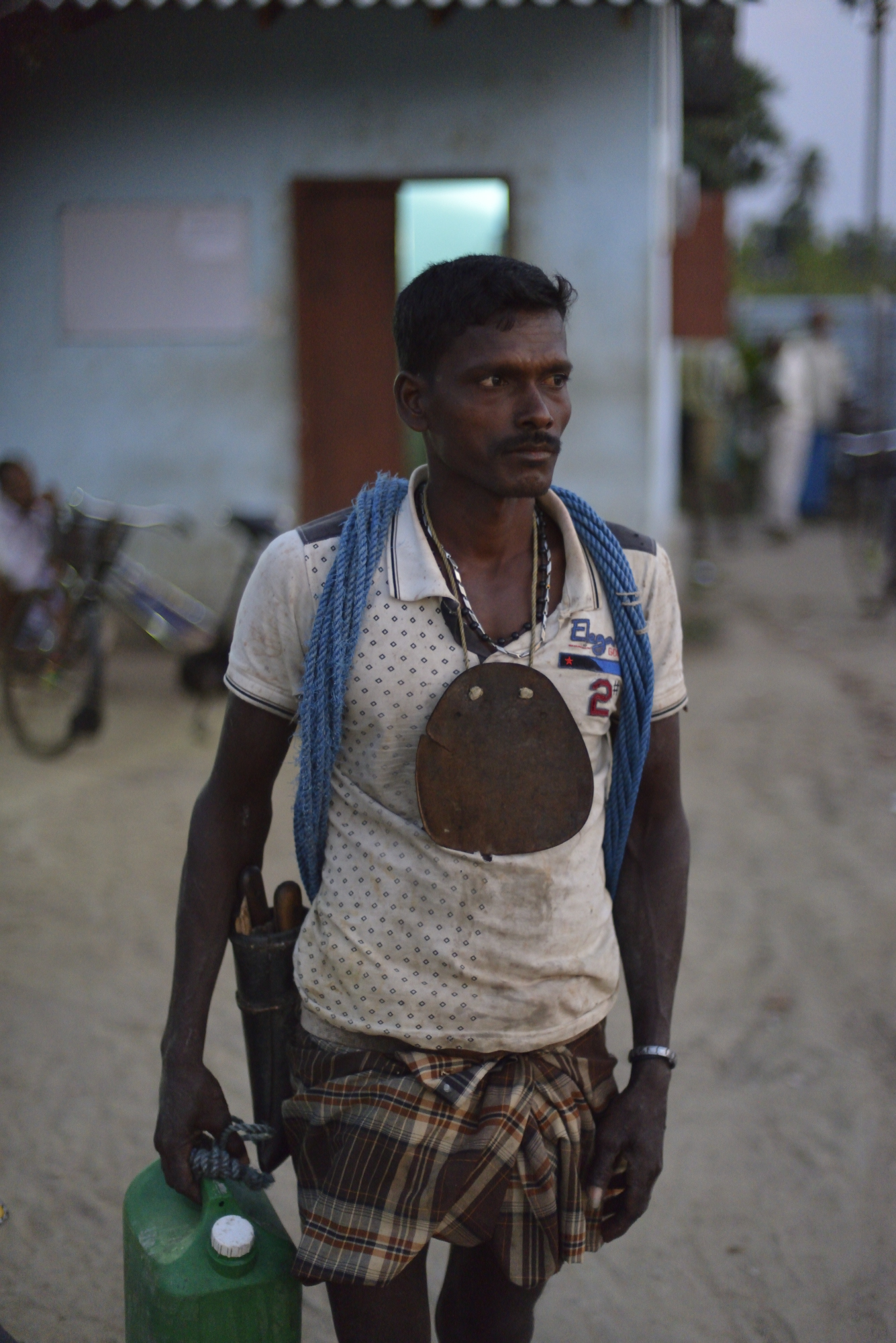 A tapper after delivering his afternoon's toddy to a cooperative.