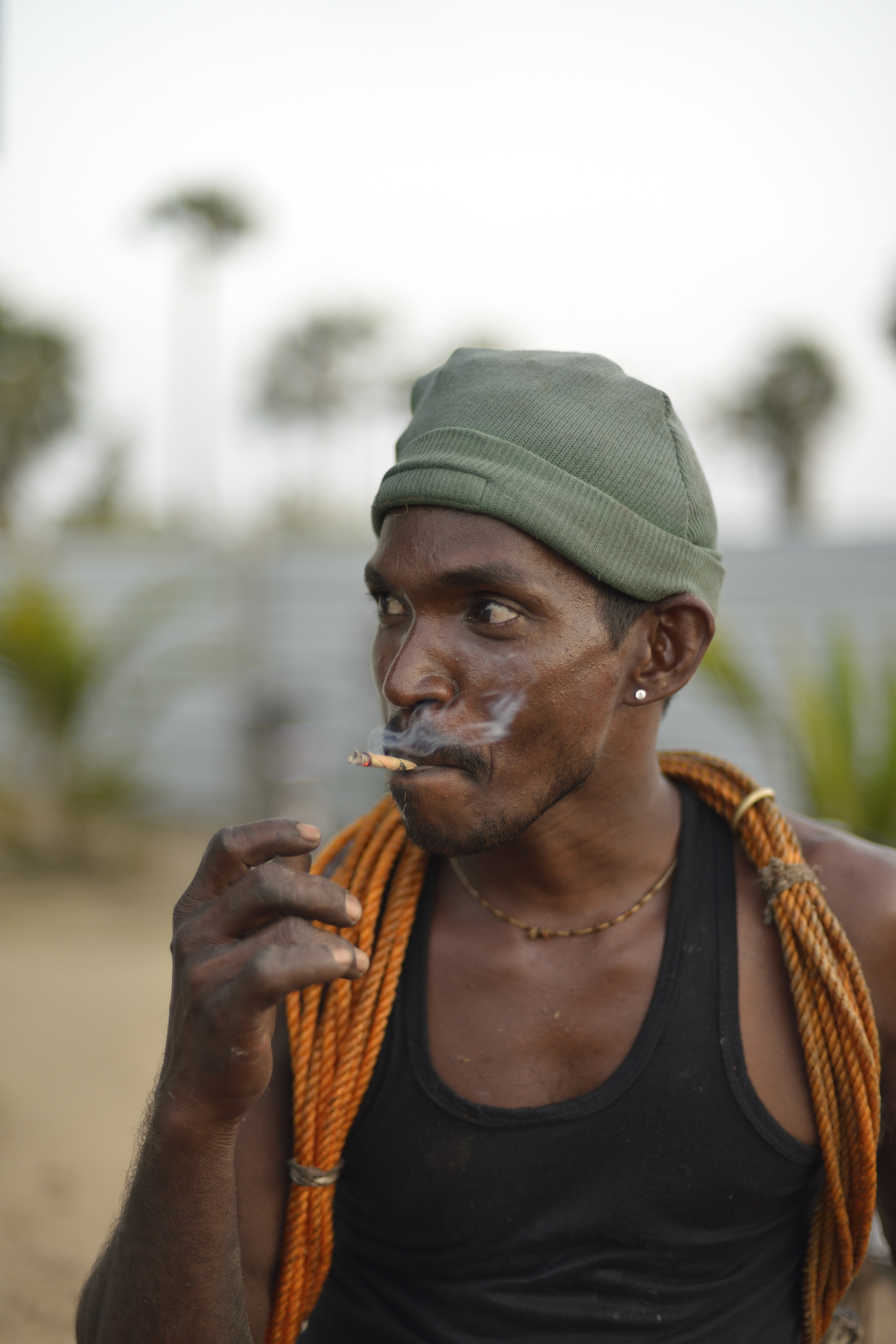 Ilavalai village cooperative. A tapper smokes a beedie at the end of a day's work.