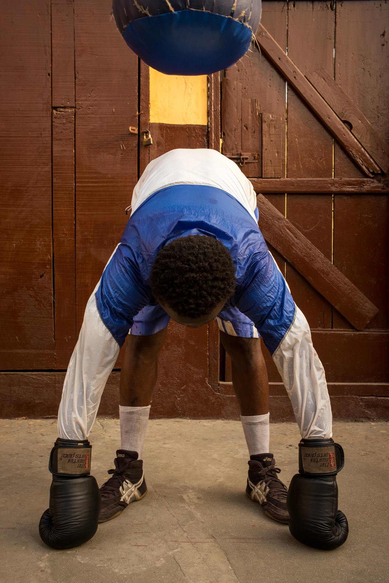 Samuel Lamptery, 19, stretching after training.  11 years of boxing: 9 Fights / 9 Victories