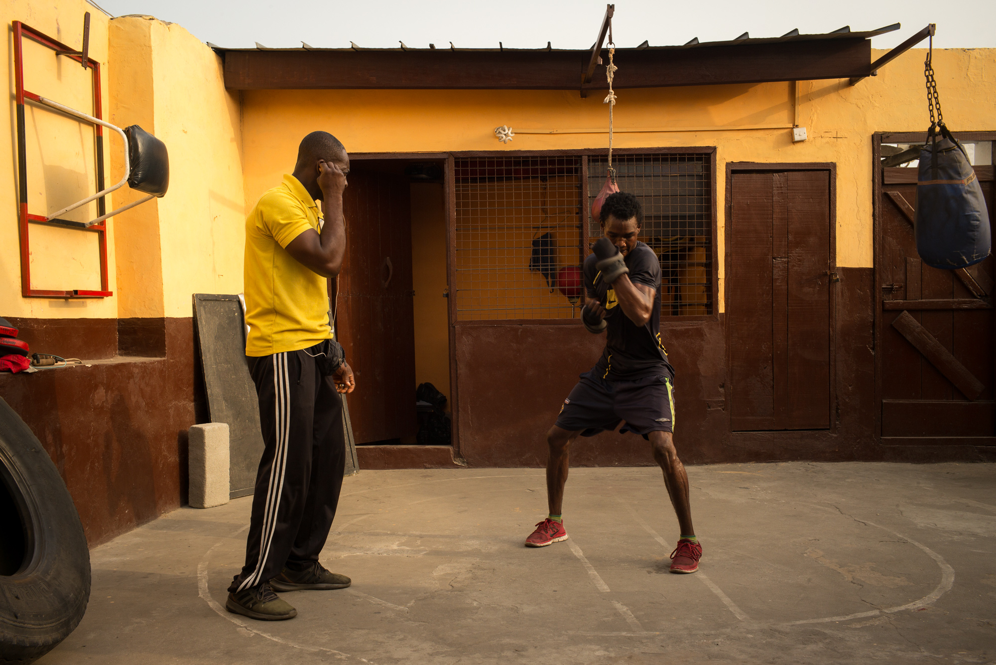 Theophilus Tetteh, 19, and his coach preparing for a fight Theophilus won on December 26th, 2018 - Discipline Boxing Academy, James Town