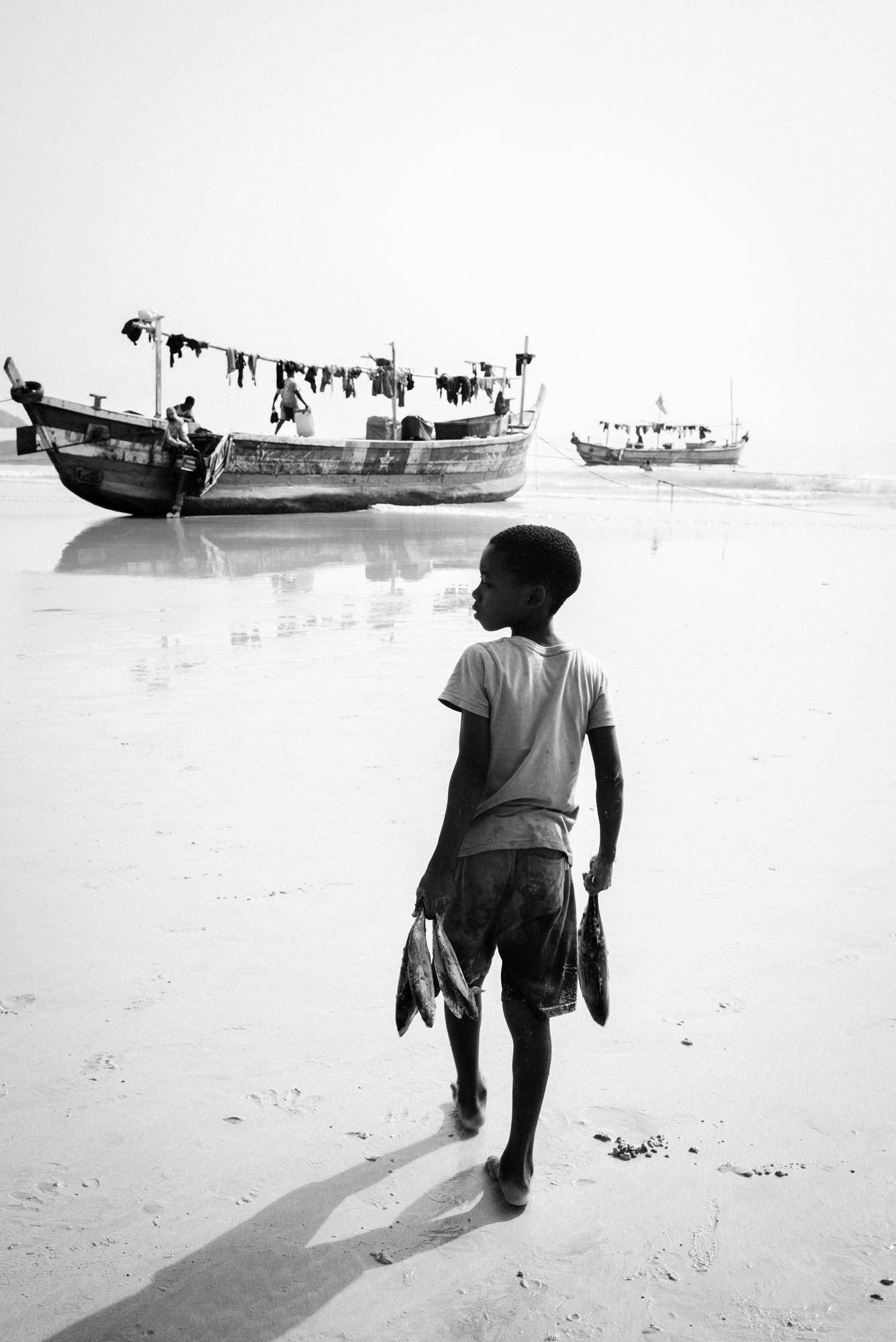 Boy with fish, Ghana 2018