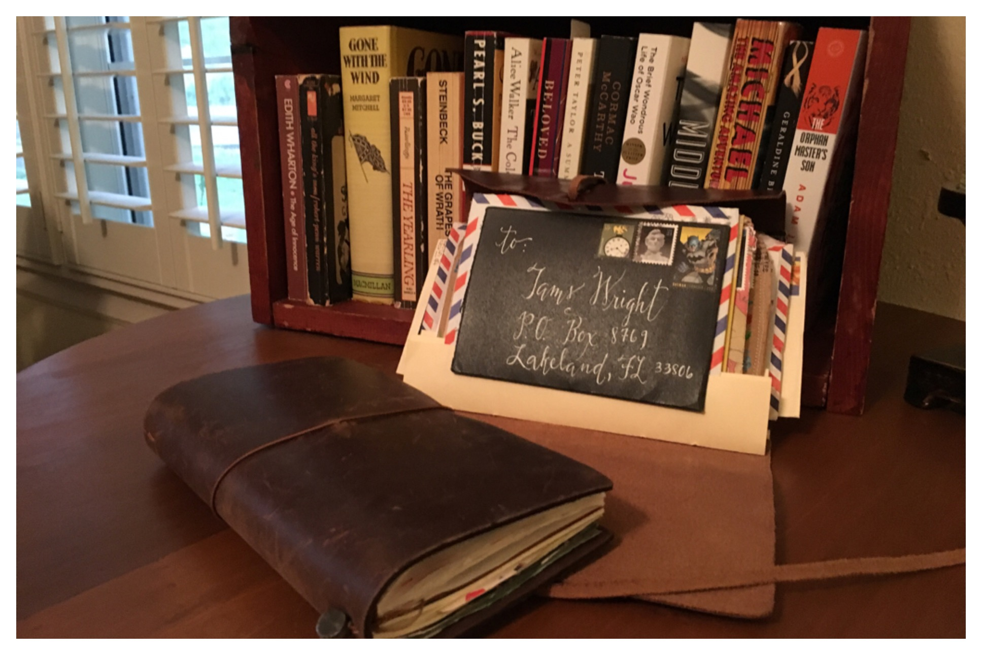Letters bound in a leather journal can be displayed along with books in your office or home library.
