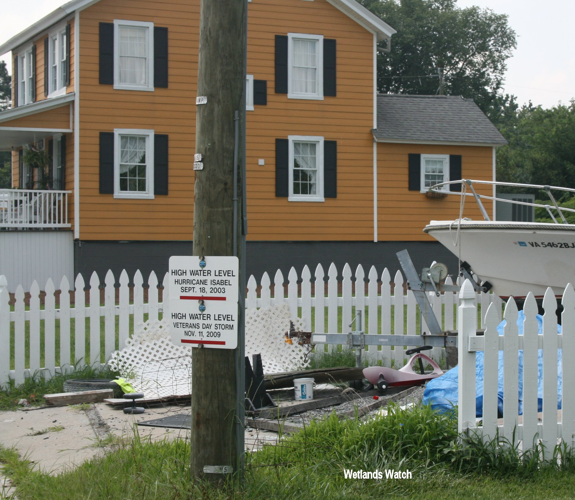 Flood Levels Recorded and House Elevated Above Them in Background