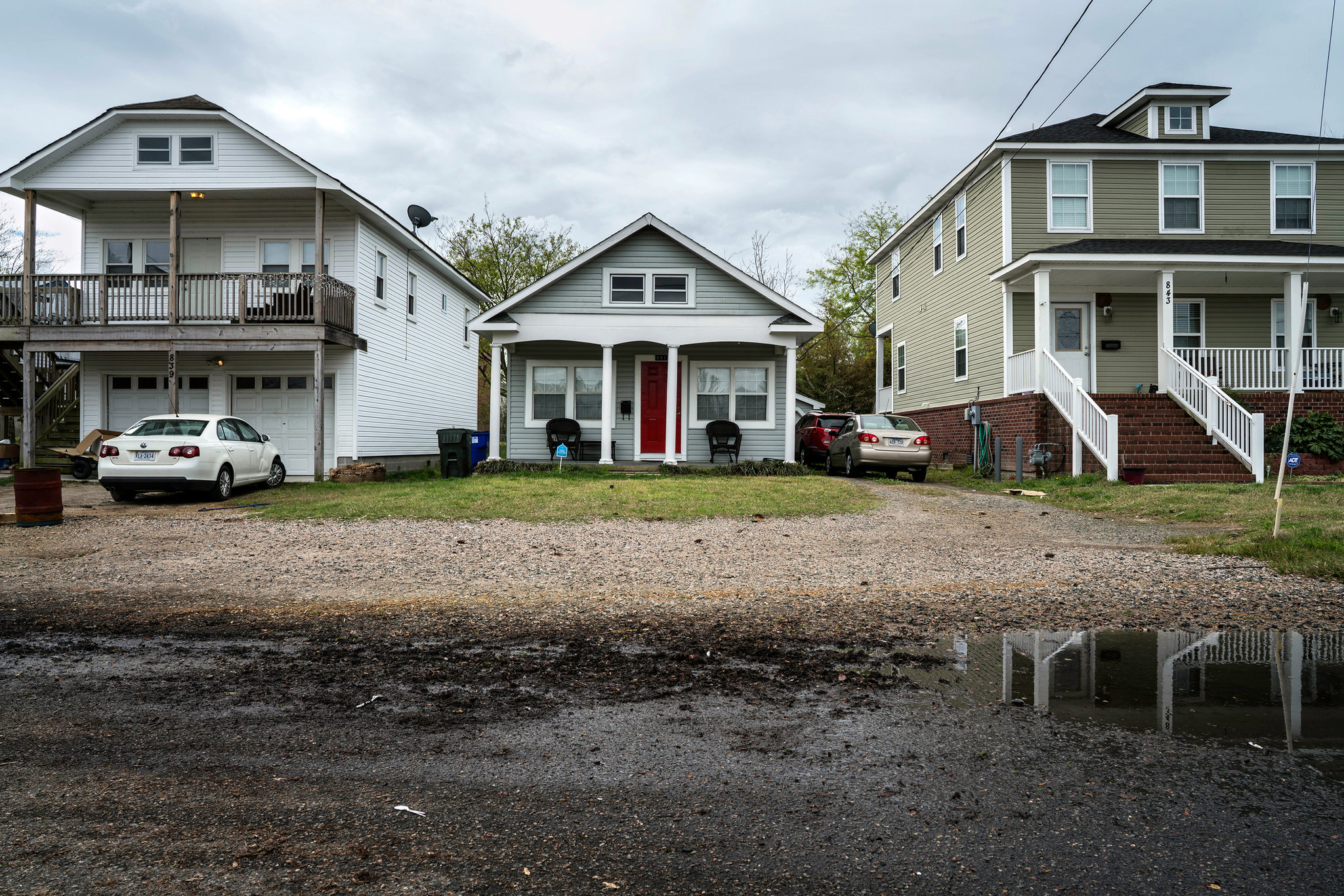 Adaptation Choices in Norfolk (l to r) - raise, wait, rebuild  (photo NYT - Benjamin Lowy)
