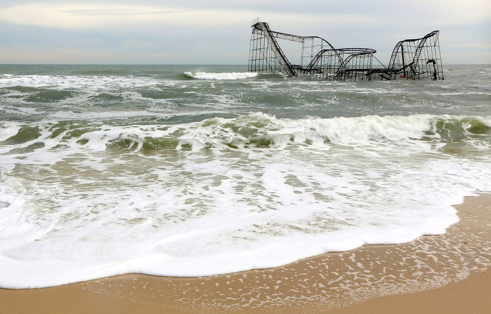 Waves break around a destroyed roller coaster in Seaside Heights, New Jersey, on Nov. 16, 2012. Photographer: Mario Tama/Getty Images