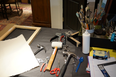 Gathering the necessary tools for canvas stretching.