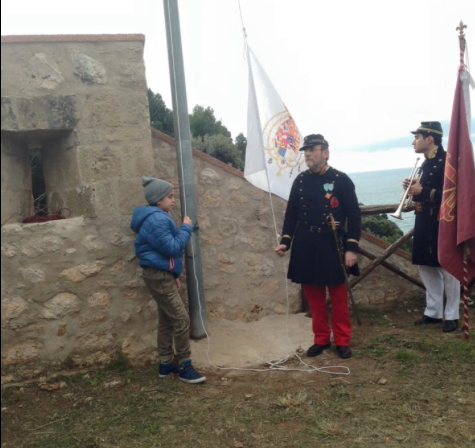 A young supporter helps raise the flag of the Two Sicilies above Gaeta.