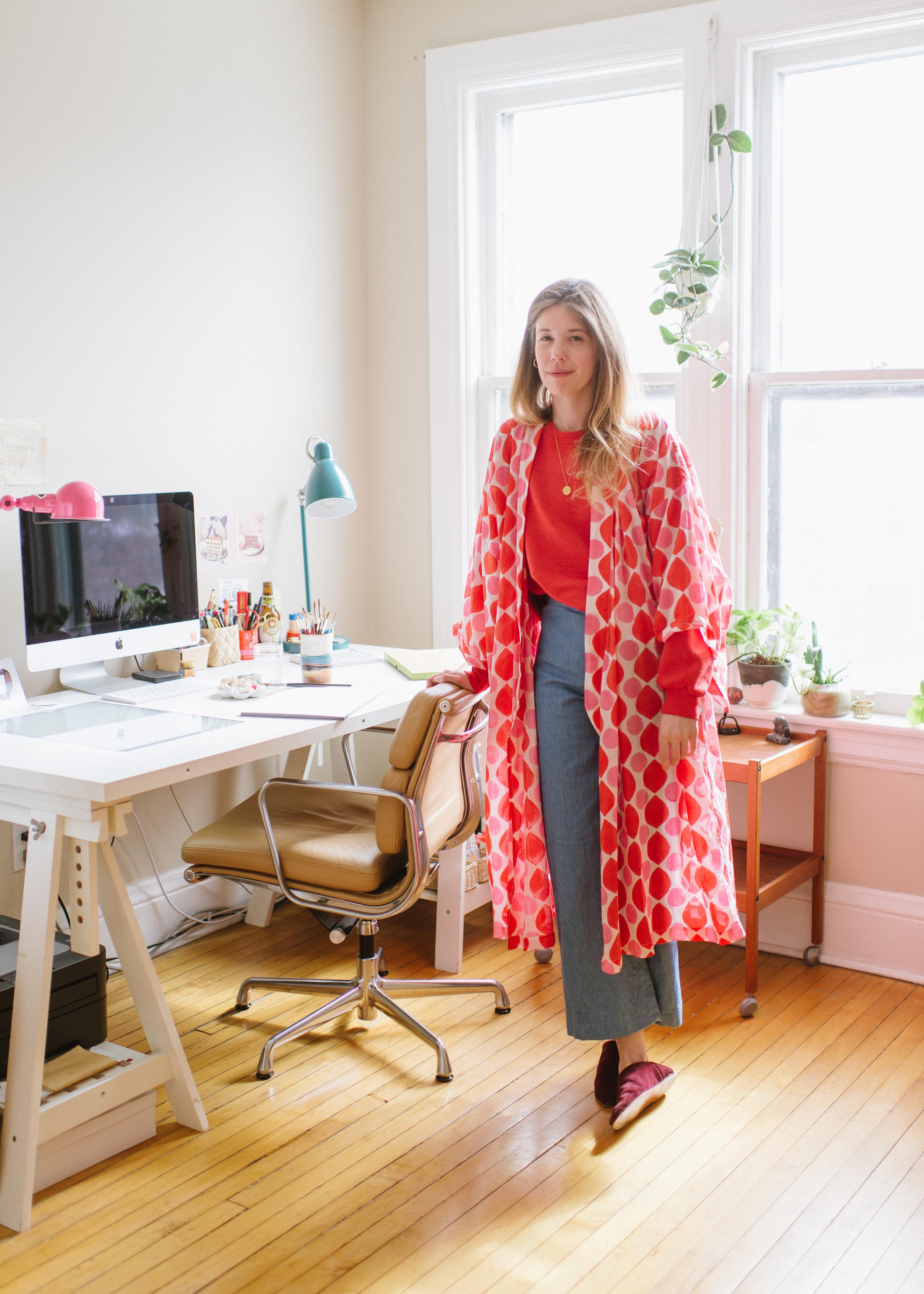 Melinda  in her home studio in Toronto, wearing the  Lena Kimono in coral drops