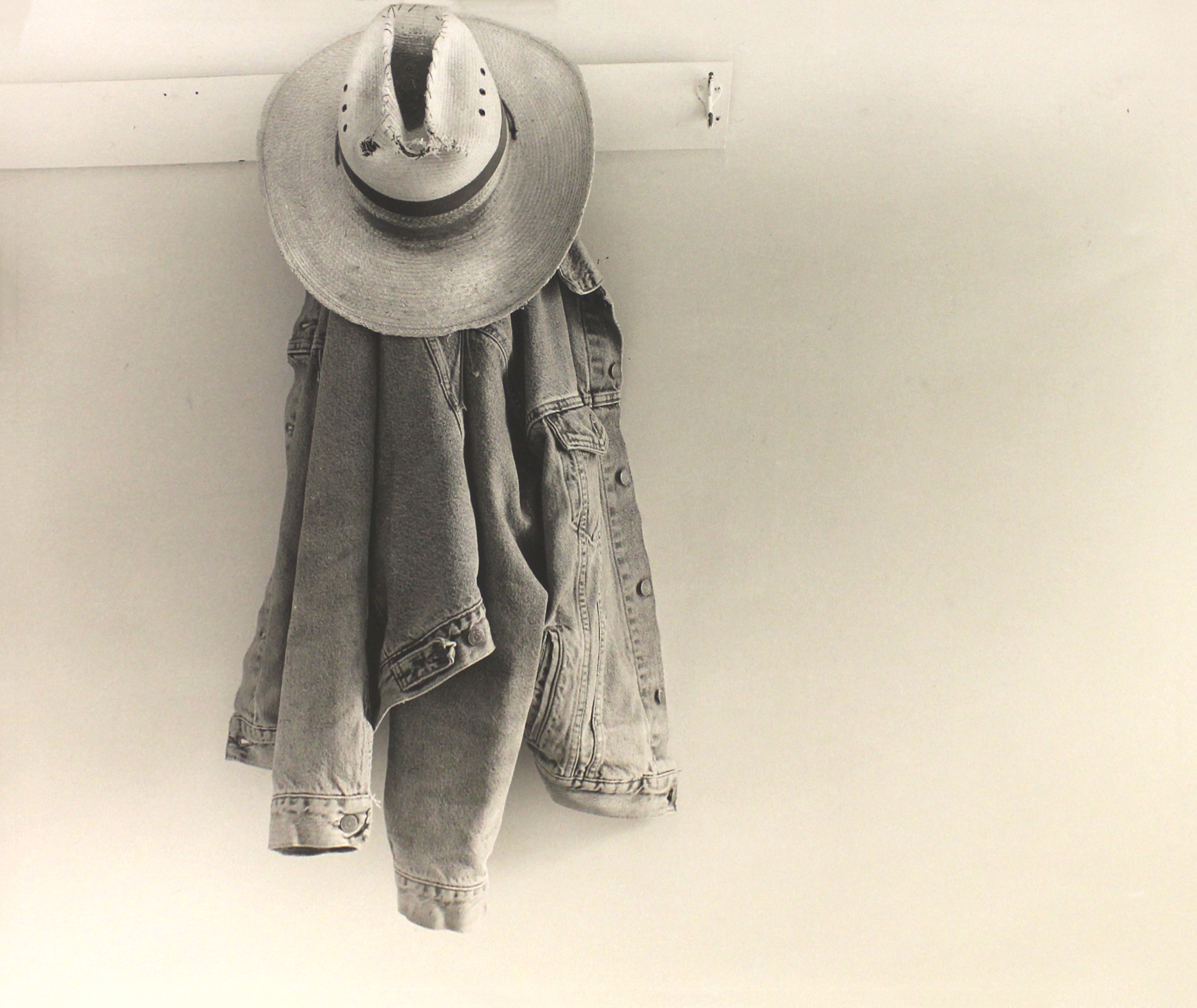 JUNE VAN CLEEF, Levi Jacket and Straw Hat on the Porch, 2001; Wood Ranch on the Highlands; Near Marfa, Presidio County, Texas, 2001