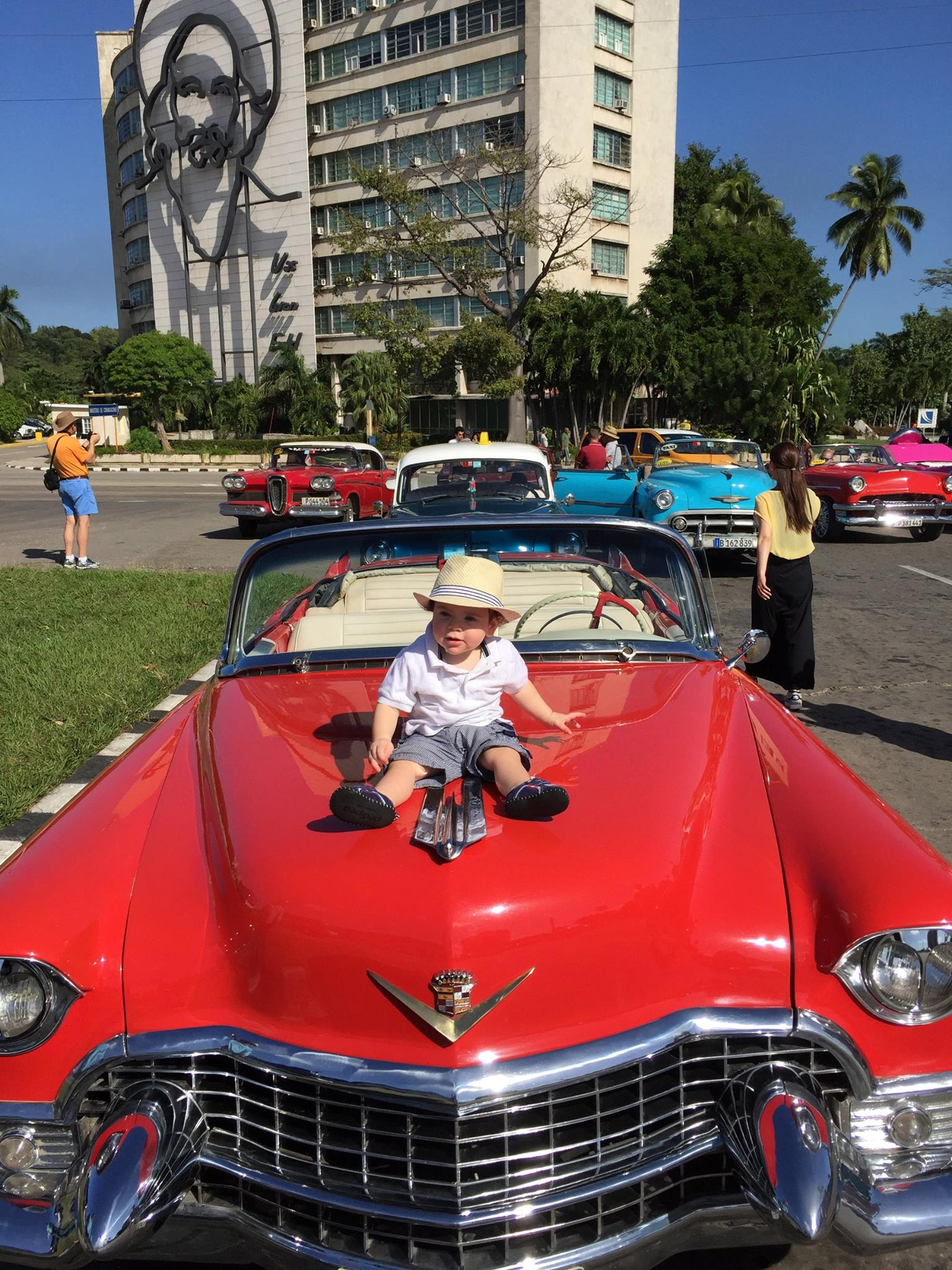 My favorite new friend, Troy aka Dabba Dabba, showing off his cuba outfit on the hood of this gorgeous car.