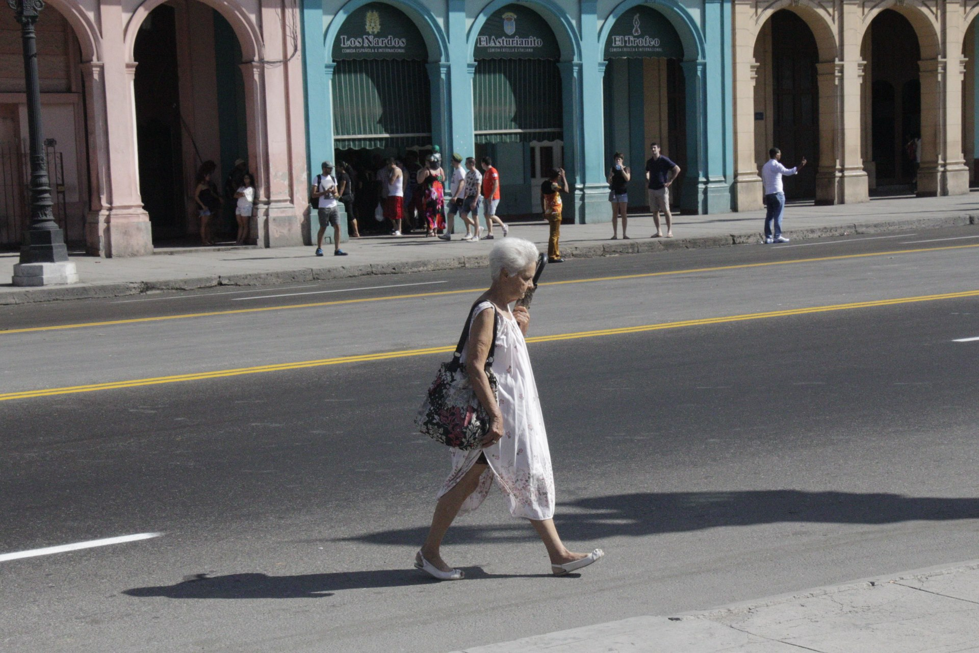 The stark imagery of Cuba is contrasted by the muted clothing of locals. With so many in poverty, the bare essentials were more norm, even in more elegant neighborhoods.