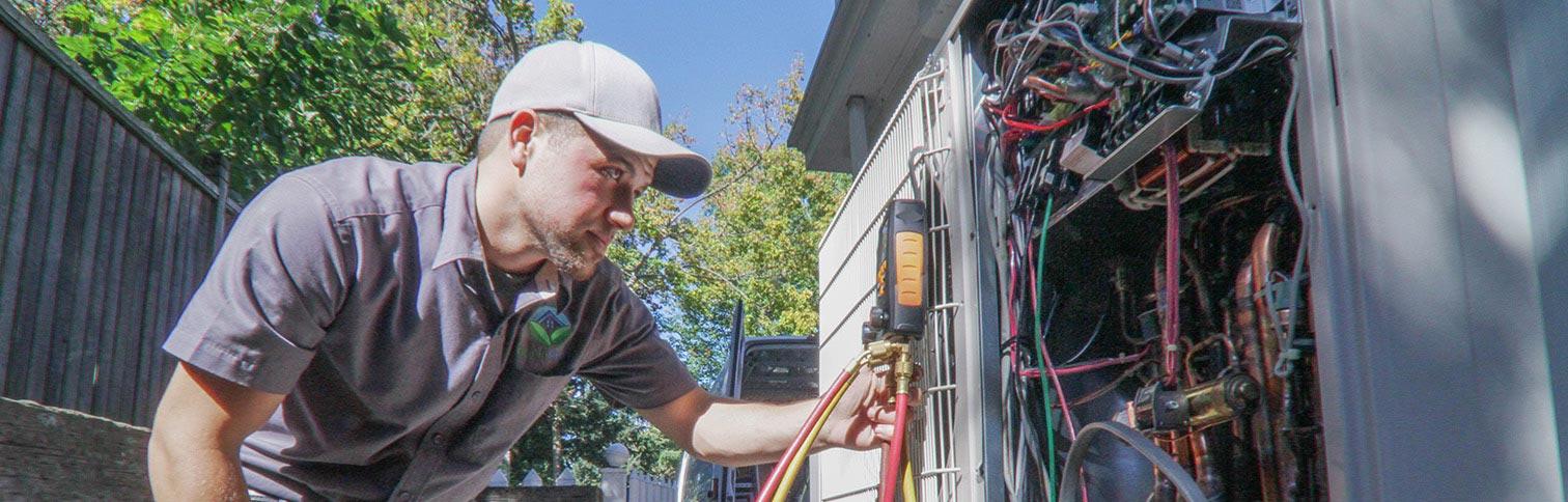 GreenSavers HVAC technician Josh E. diagnoses an underperforming AC system.