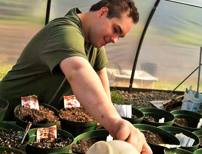 "Founding Farmer Charles ""Chucky"" Brongo working in the greenhouse"