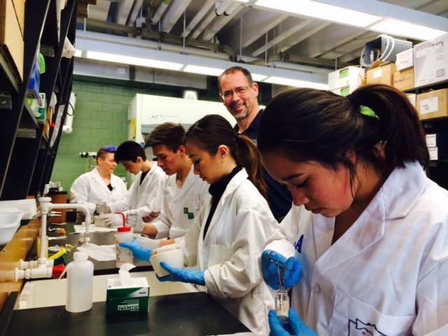 Youth researchers, Lenita Alatini, Jared Dulac (Kluane First Nation's Youth Councillor), and Nadaya Johnson,are hard at work on the analysis